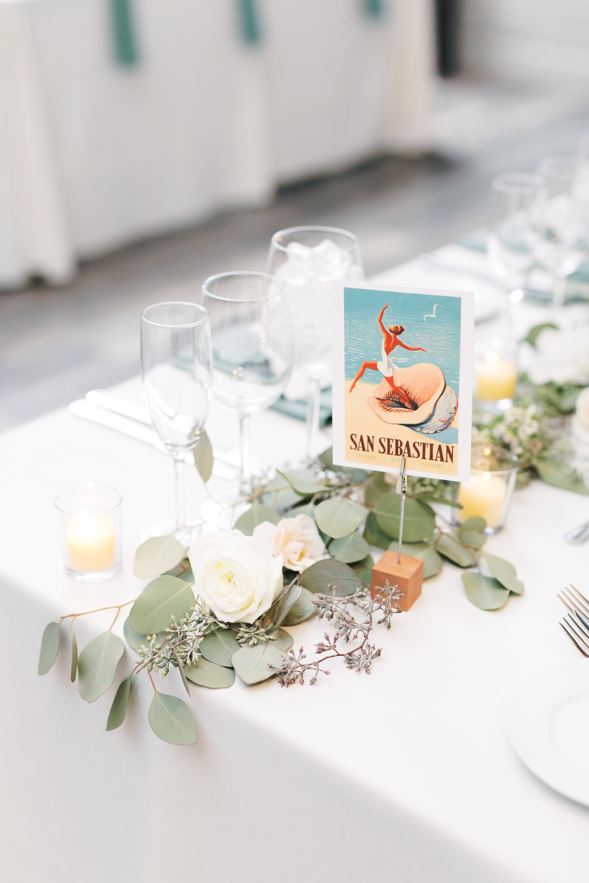 Reception setup at FAME, industrial and modern warehouse Philadelphia wedding venue by Haley Richter Photography with travel themed details