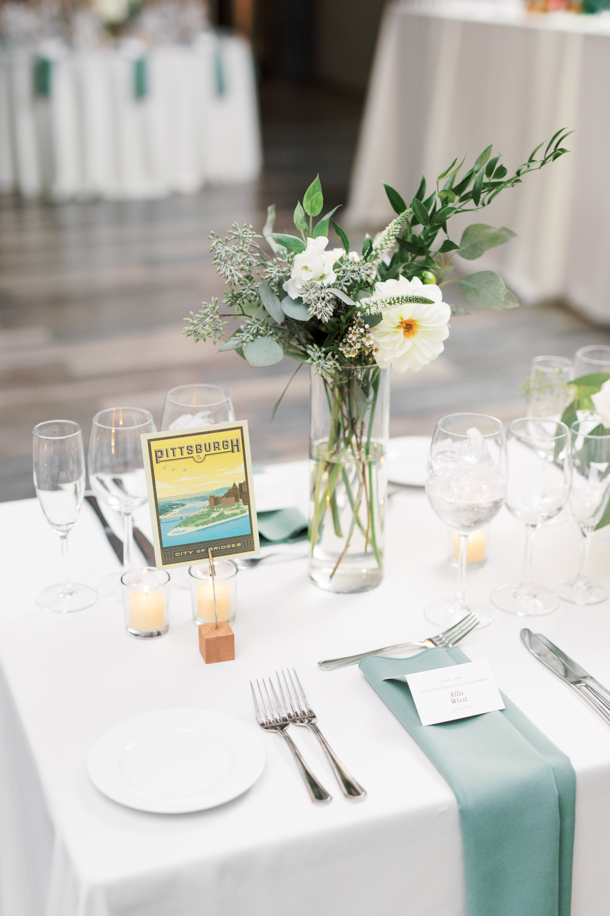 Travel themed reception details at FAME, industrial and modern warehouse Philadelphia wedding venue