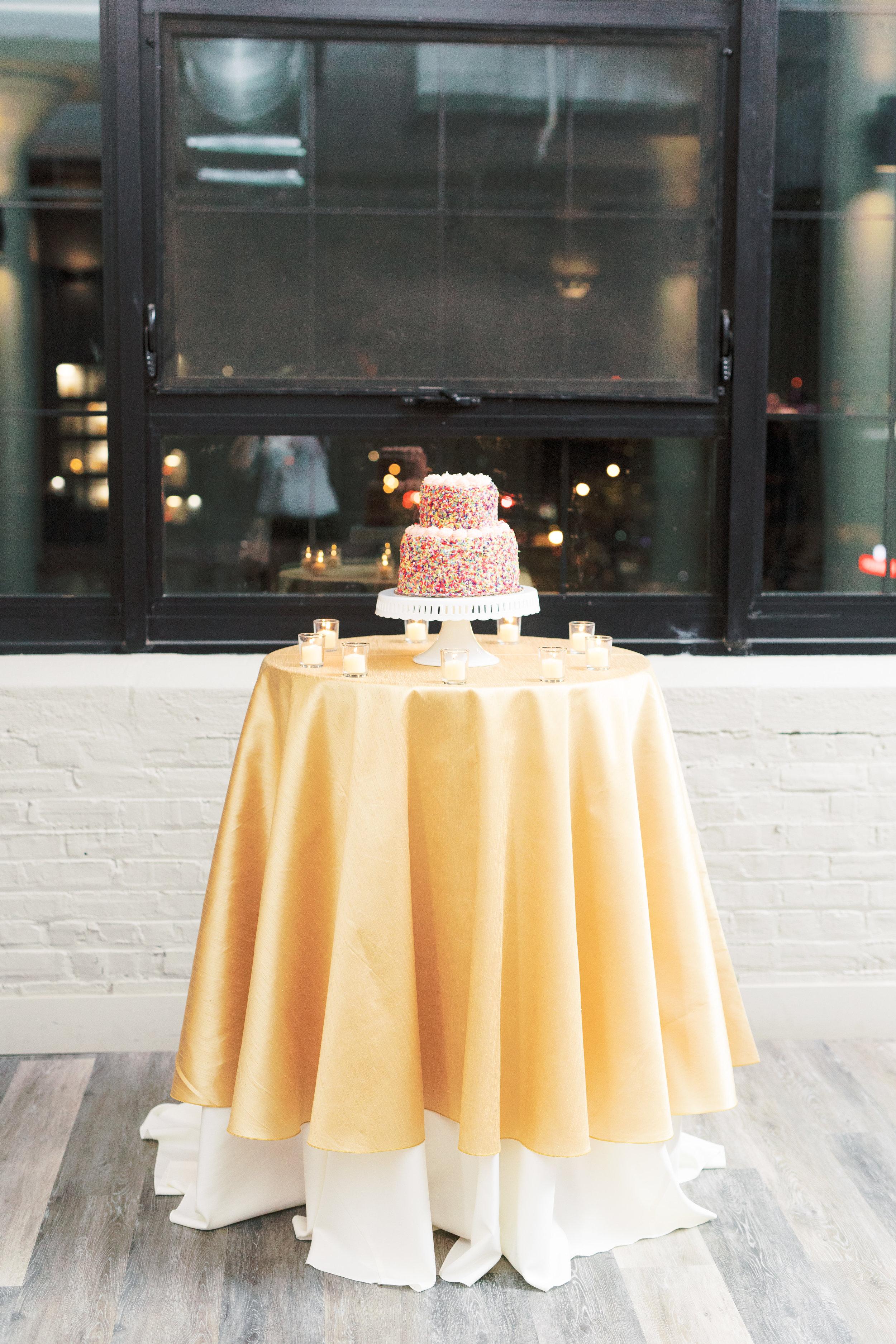 colorful and fun confetti sprinkle wedding cake