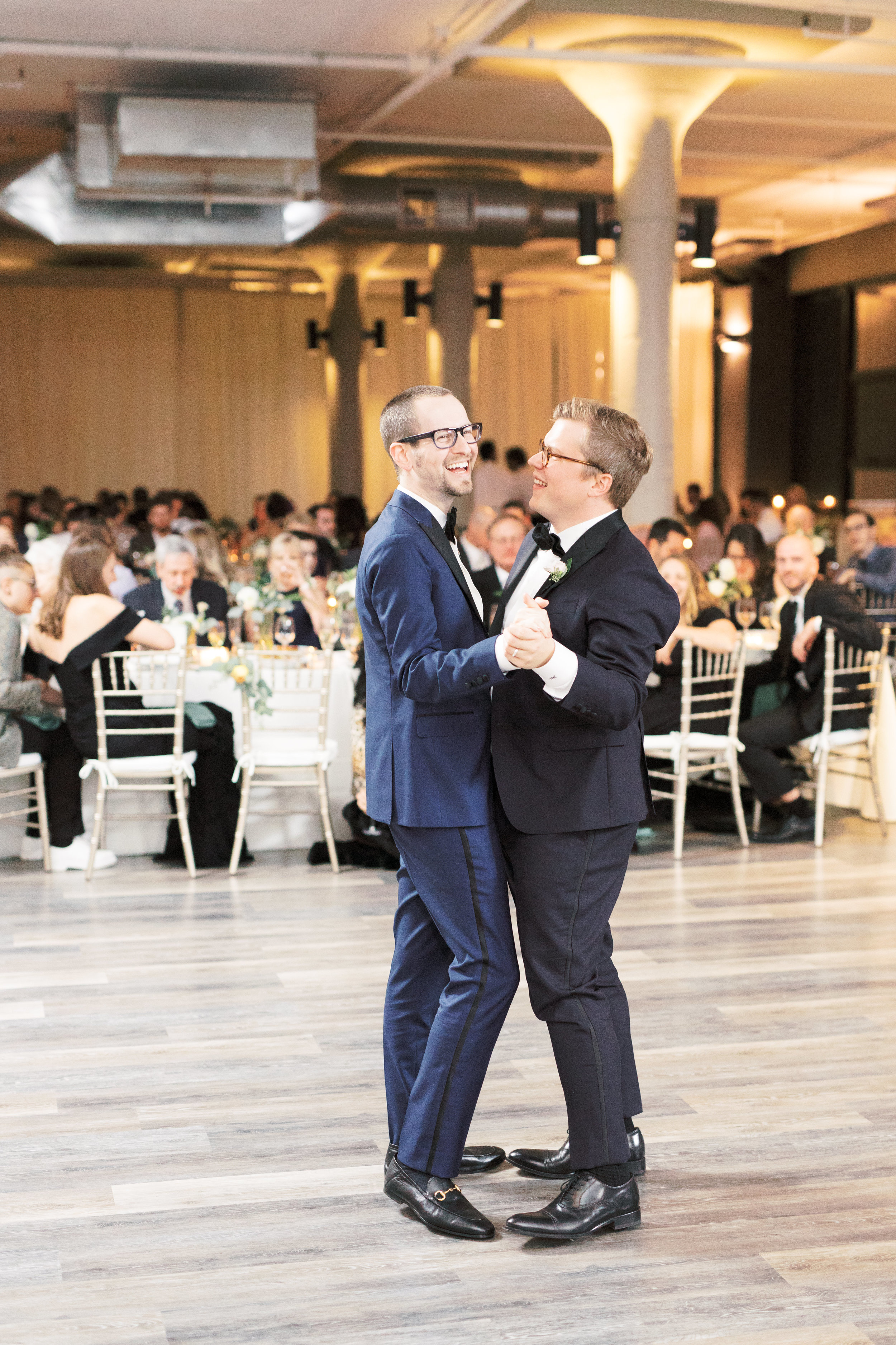 two grooms sharing their first dance as husbands at FAME, Philadelphia wedding venue