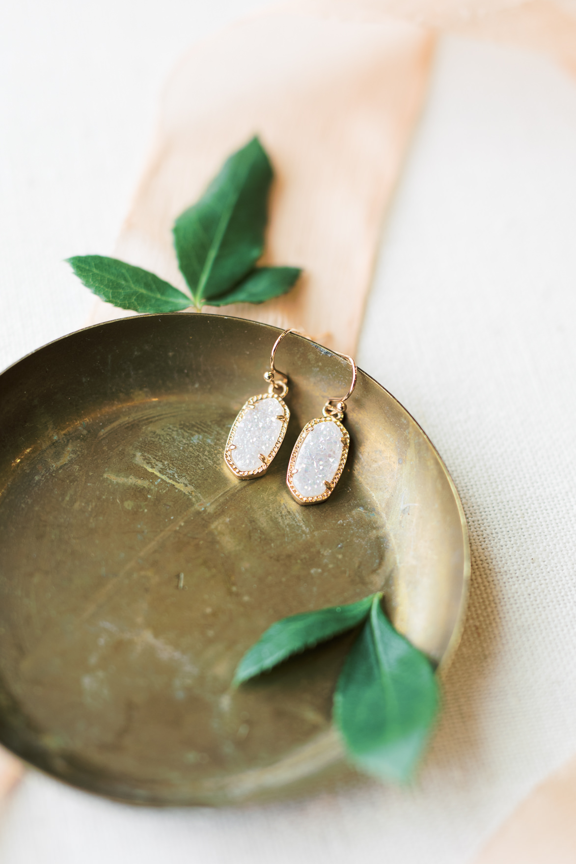 these modern white and gold crystal earrings were such a sweet touch to Missy and Dani's modern and elegant old city Philadelphia wedding at Power Plant Productions. Power Plant Production wedding photographer