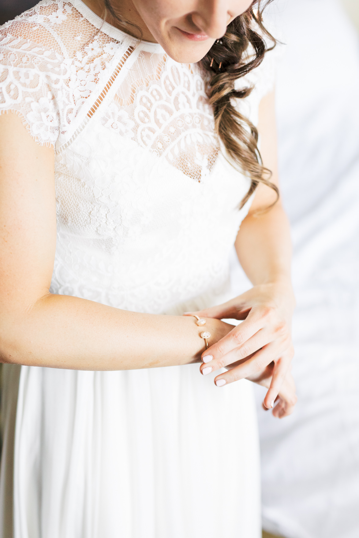 Those little finishing touches of putting on jewelry are some of our favorite moments to capture, like this shot of Missy getting ready for her modern and elegant old city Philadelphia wedding at Power Plant Productions. Power Plant Production wedding photographer