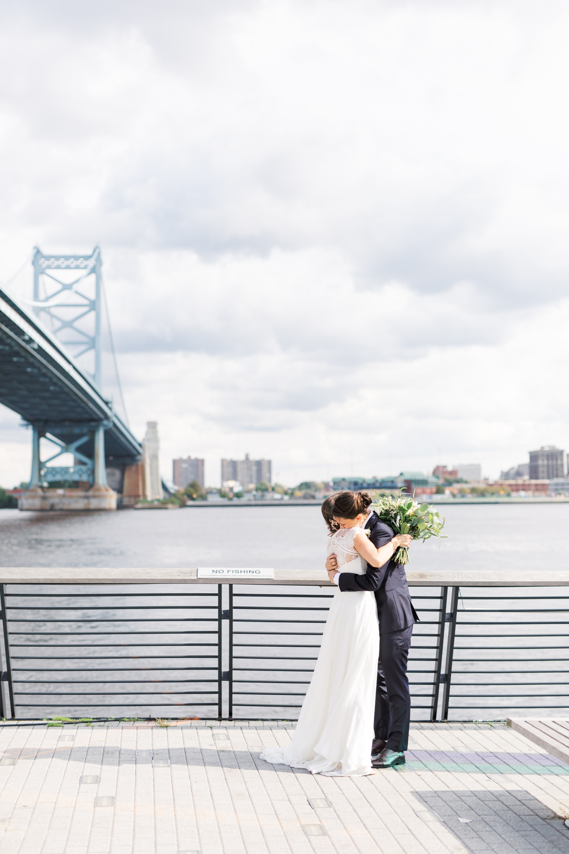 Race Street Pier is the perfect location for portraits just outside of their venue for this modern and elegant old city Philadelphia wedding at Power Plant Productions. Power Plant Production wedding photographer