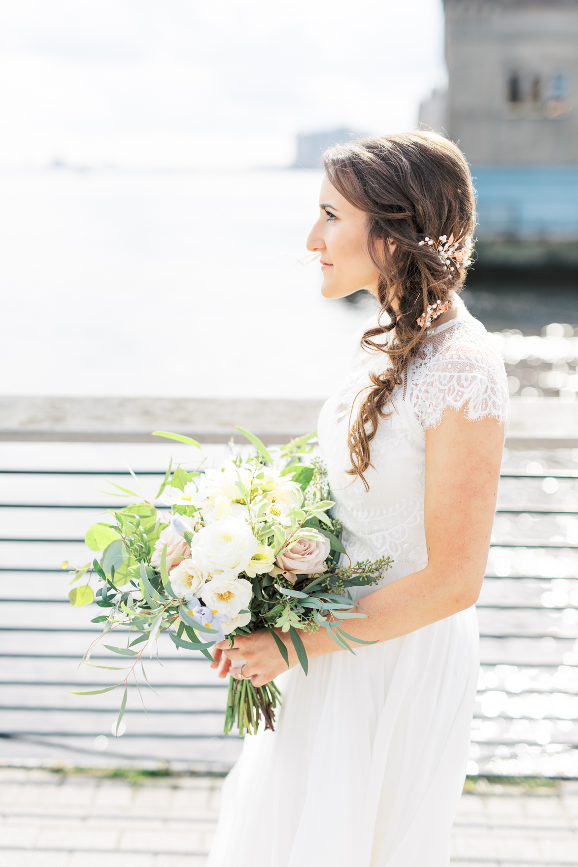 We love how Missy's wedding day look came together, her fairytale like hair sweeping to the side in loose curls, her modern lace topped wedding dress, and a wild and whimsical bouquet from Vault + Vine made this day a truly modern and elegant old city Philadelphia Power Plant Productions wedding. Power Plant Production wedding photographer