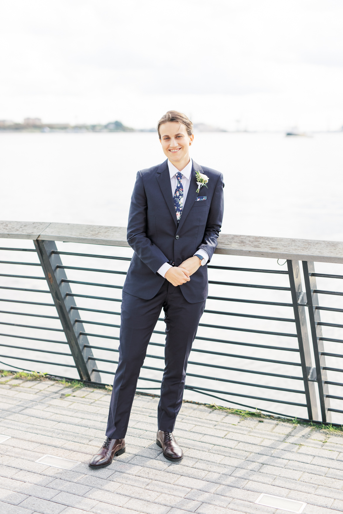2018 was the year of blue suits, and we loved how Dani paired hers with a floral tie, adding a little bit of a twist for her modern and elegant old city Philadelphia Power Plant Productions wedding. Power Plant Production wedding photographer