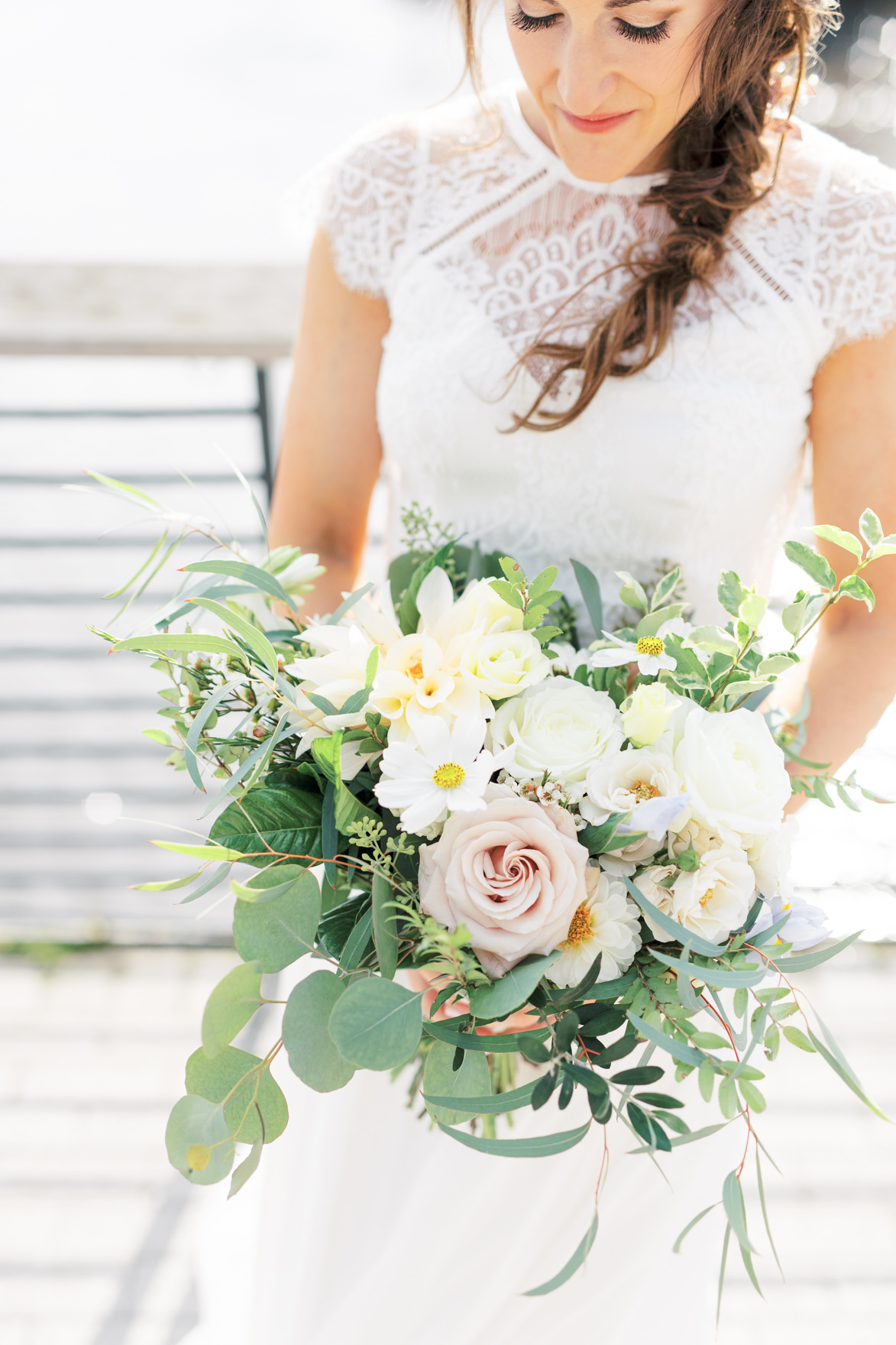 We cannot get over how gorgeous this wild and whimsical bouquet from Vault + Vine is. It's mostly neutral shades of white and blush, but little pops of yellow really made this arrangement shine for Missy and Dani's modern and elegant old city Philadelphia Power Plant Productions wedding. Power Plant Production wedding photographer