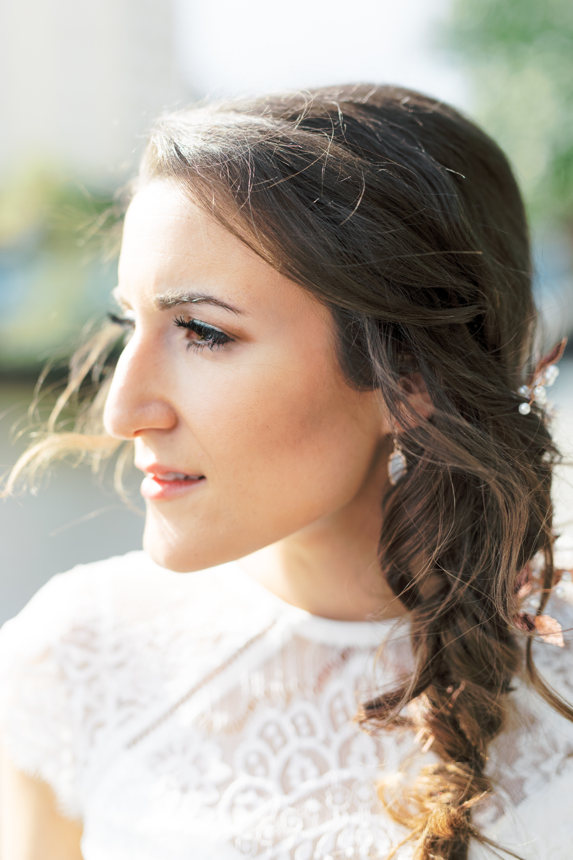 We love how soft and romantic Missy's draped side hairdo with soft curls was for her modern and elegant old city Philadelphia Power Plant Productions wedding. Power Plant Production wedding photographer