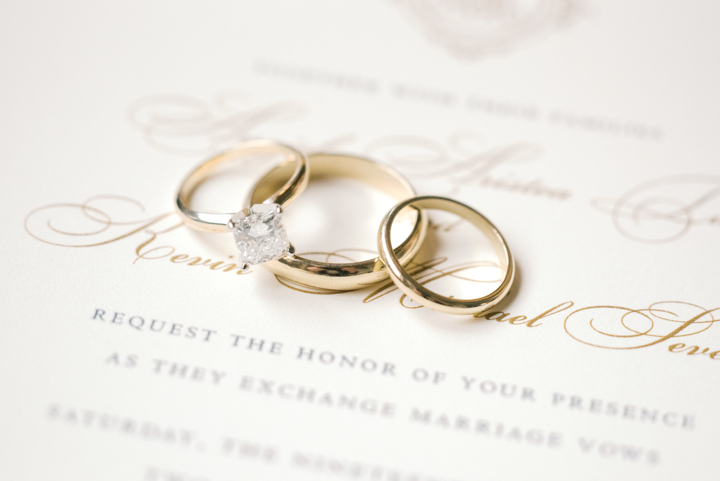 We love these classic gold wedding bands with a white diamond engagement ring from this romantic and classic wedding day for their french inspired green and white Cairnwood Estate wedding