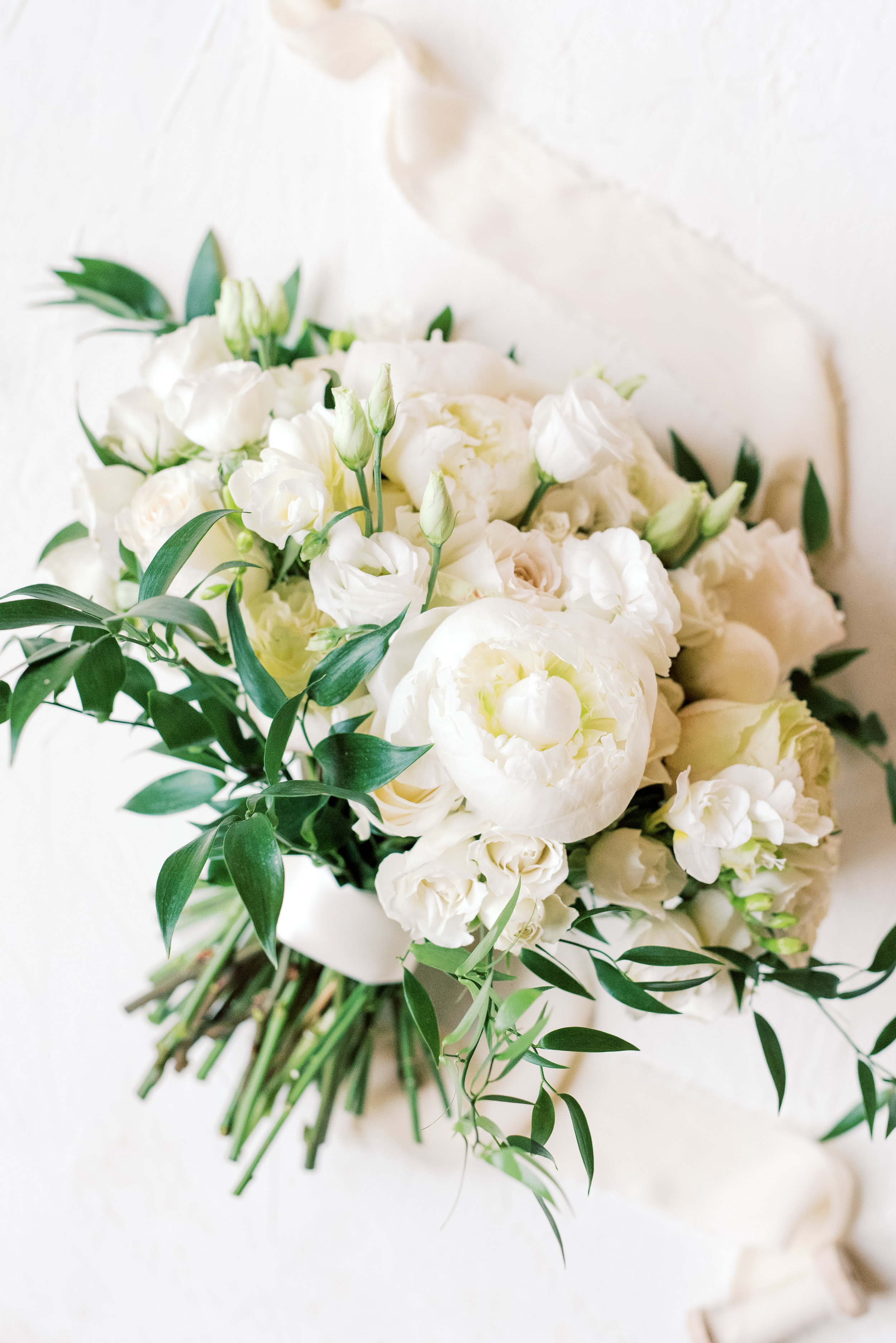 We love a classic white bouquet done exceptionally well, loose blooms are our favorite from this romantic and classic wedding day for their french inspired green and white Cairnwood Estate wedding.