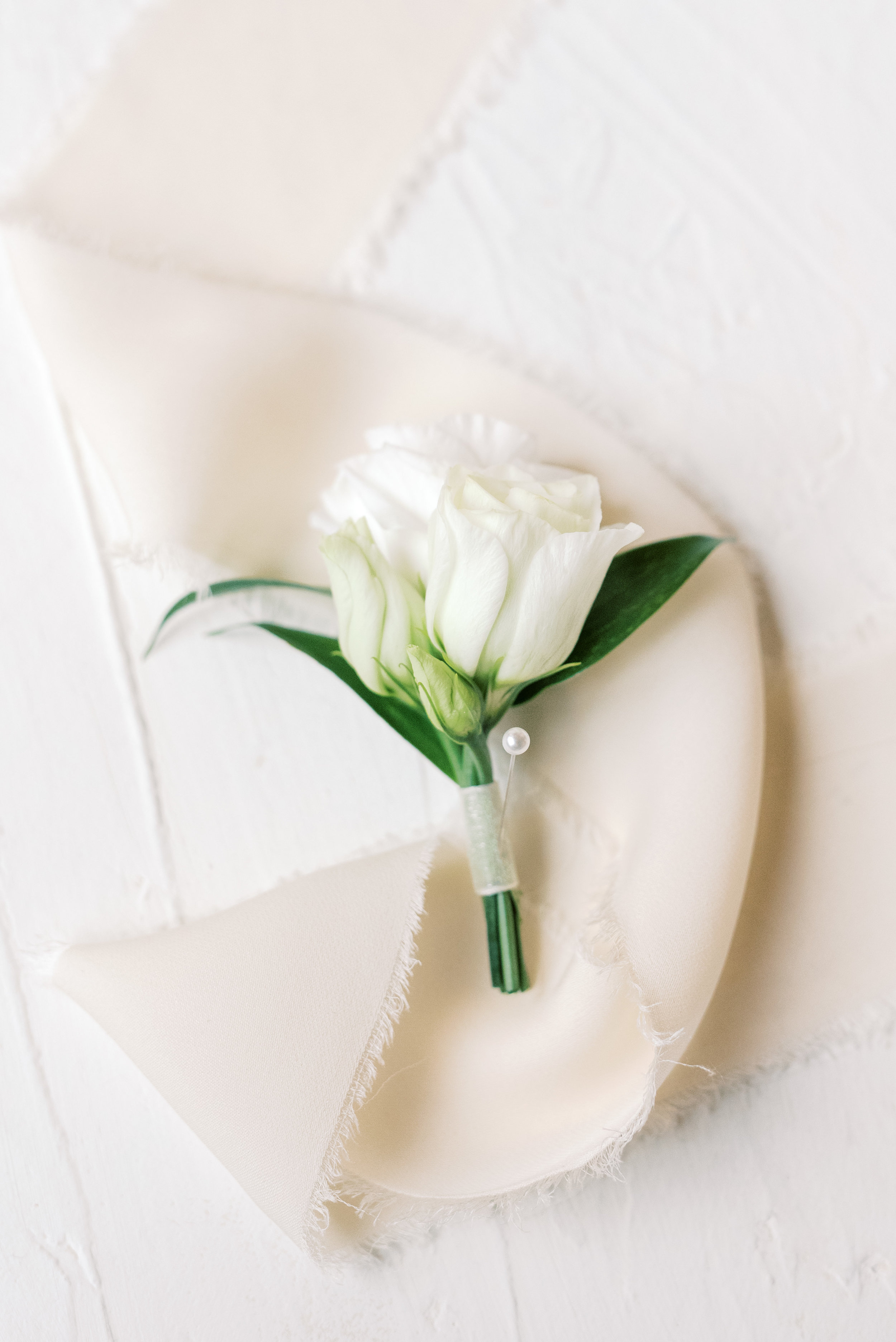 This simple white boutonniere was a perfect accent to this romantic and classic wedding day for their french inspired green and white Cairnwood Estate wedding
