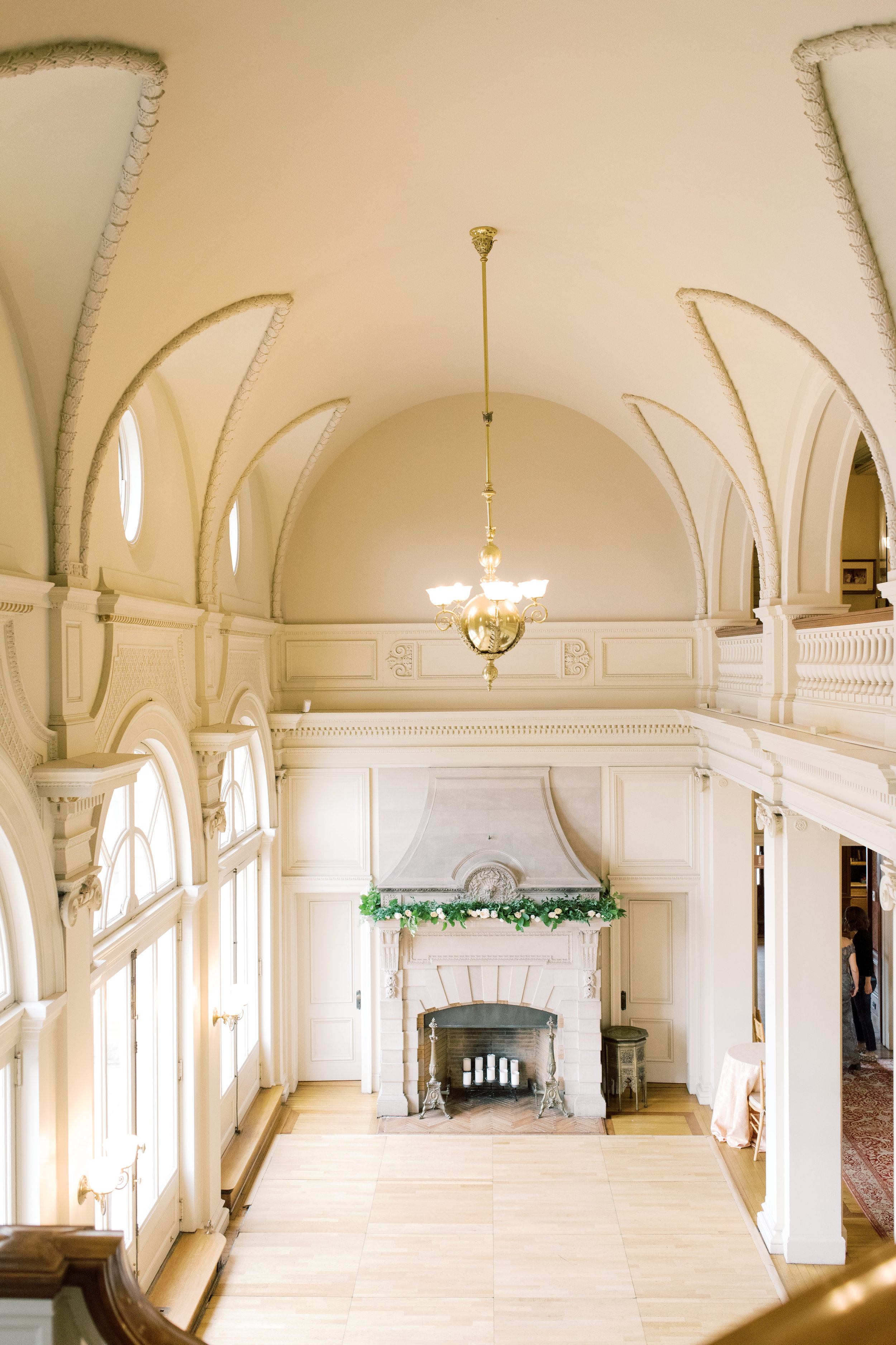 The great hall with stone fireplace added such a touch of elegance for this romantic and classic wedding day for their french inspired green and white Cairnwood Estate wedding