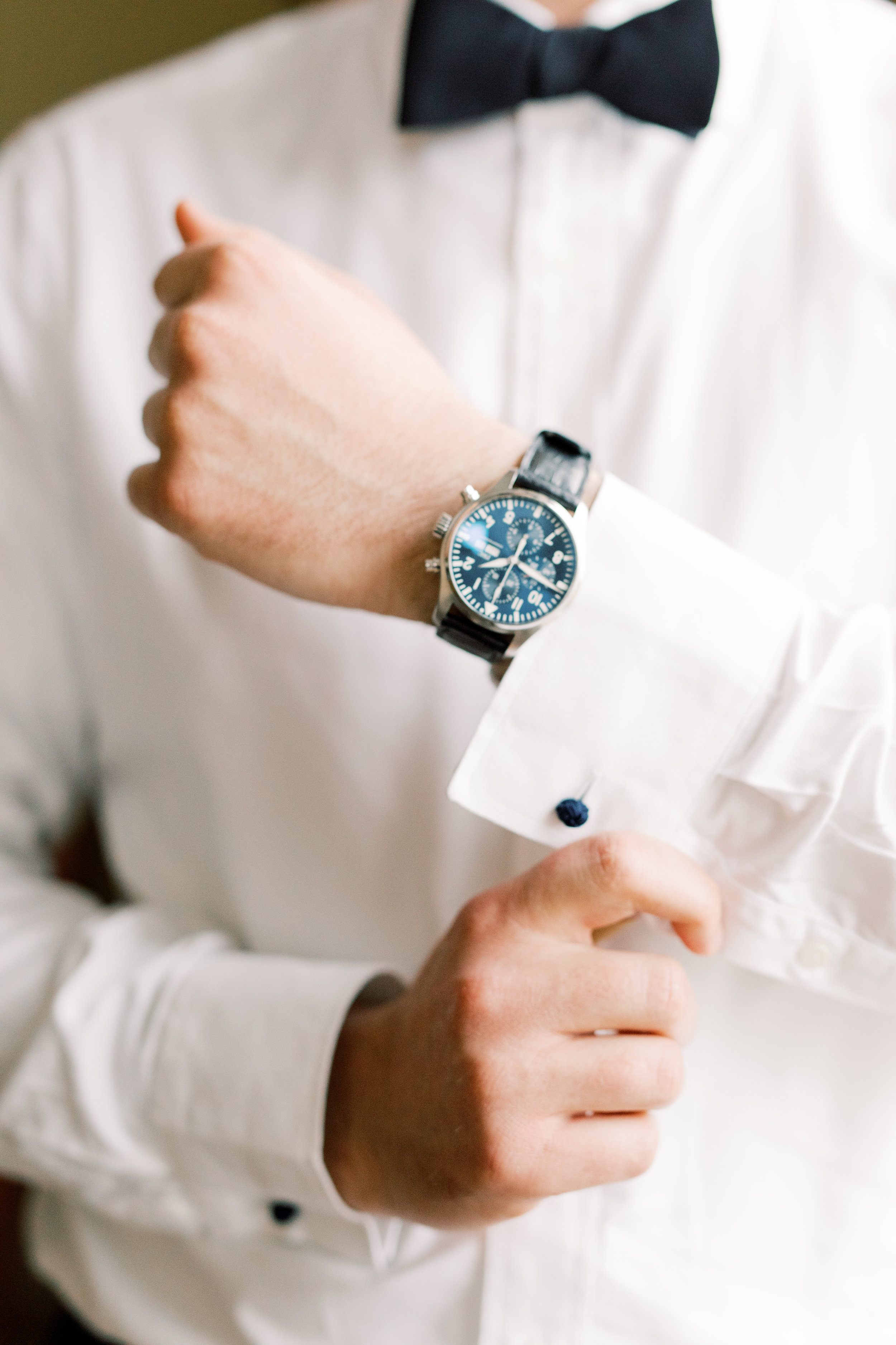 A clssy timepiece is always welcome on our grooms, like this blue watch from this romantic and classic wedding day for their french inspired green and white Cairnwood Estate wedding