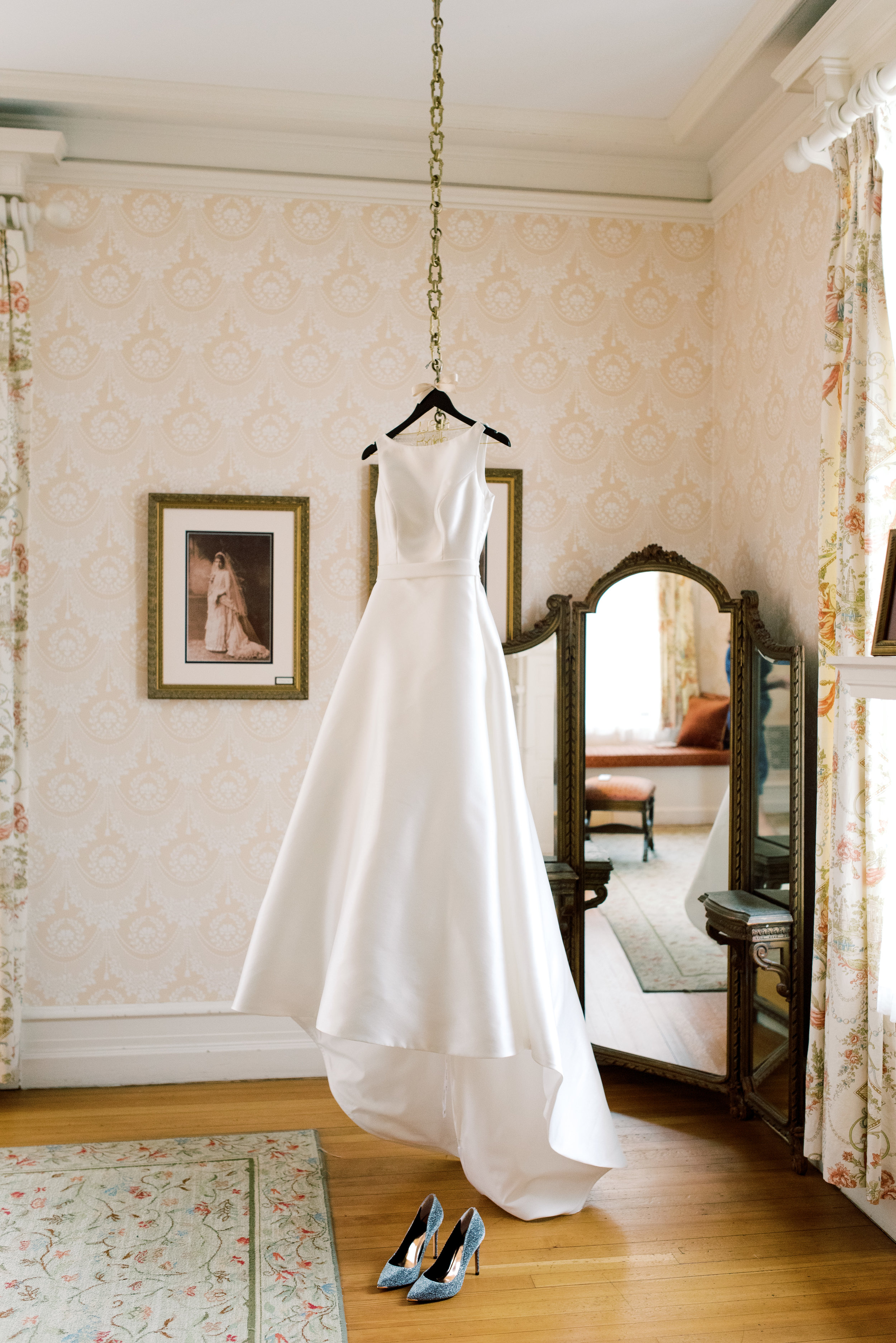 The clean lines of this modern a-line wedding dress were a perfect classic look for this romantic and classic wedding day for their french inspired green and white Cairnwood Estate wedding