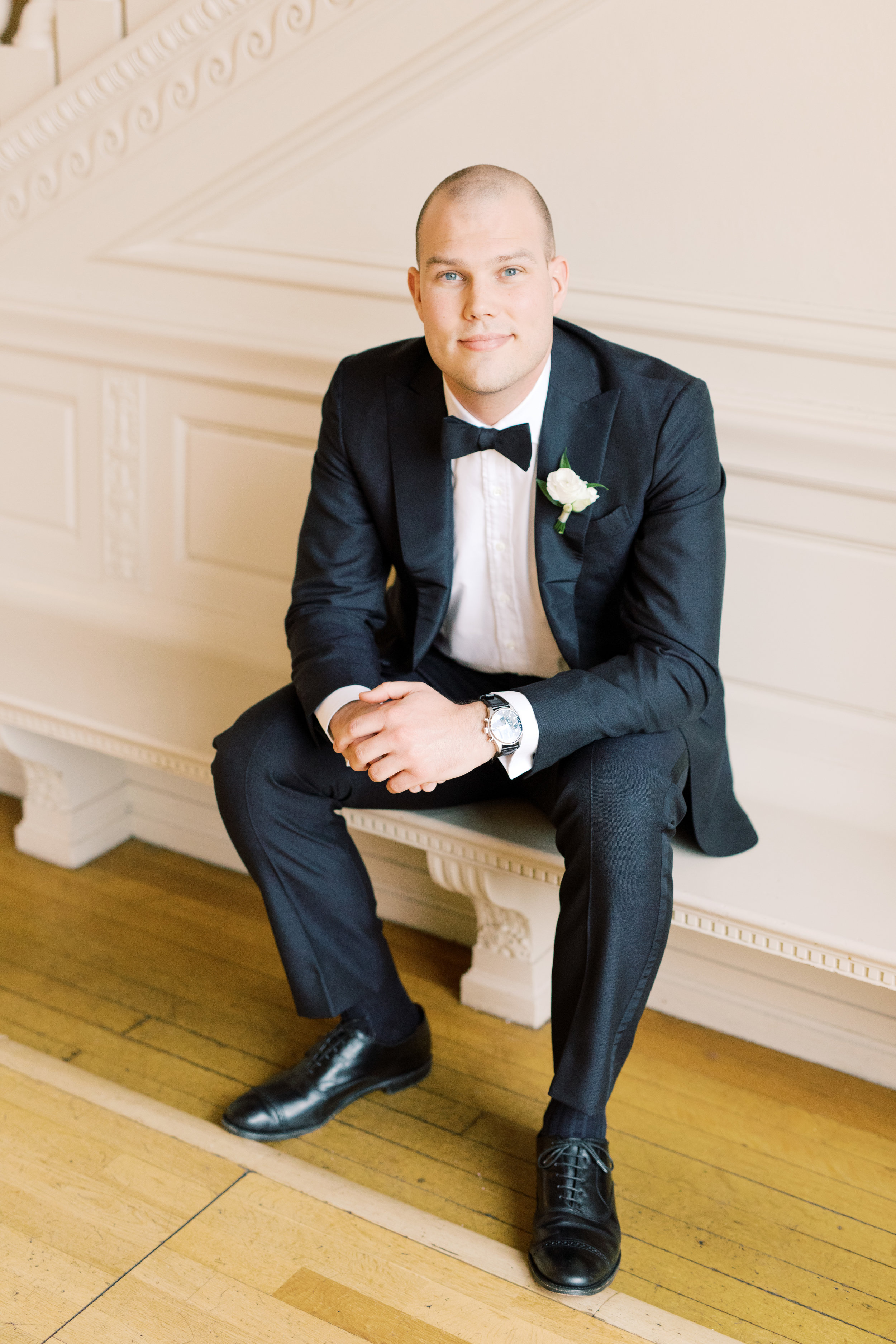 We couldn't get enough of Kevin's simple and classic black and white groom's look topped with a bowtie for this romantic and classic wedding day for their french inspired green and white Cairnwood Estate wedding