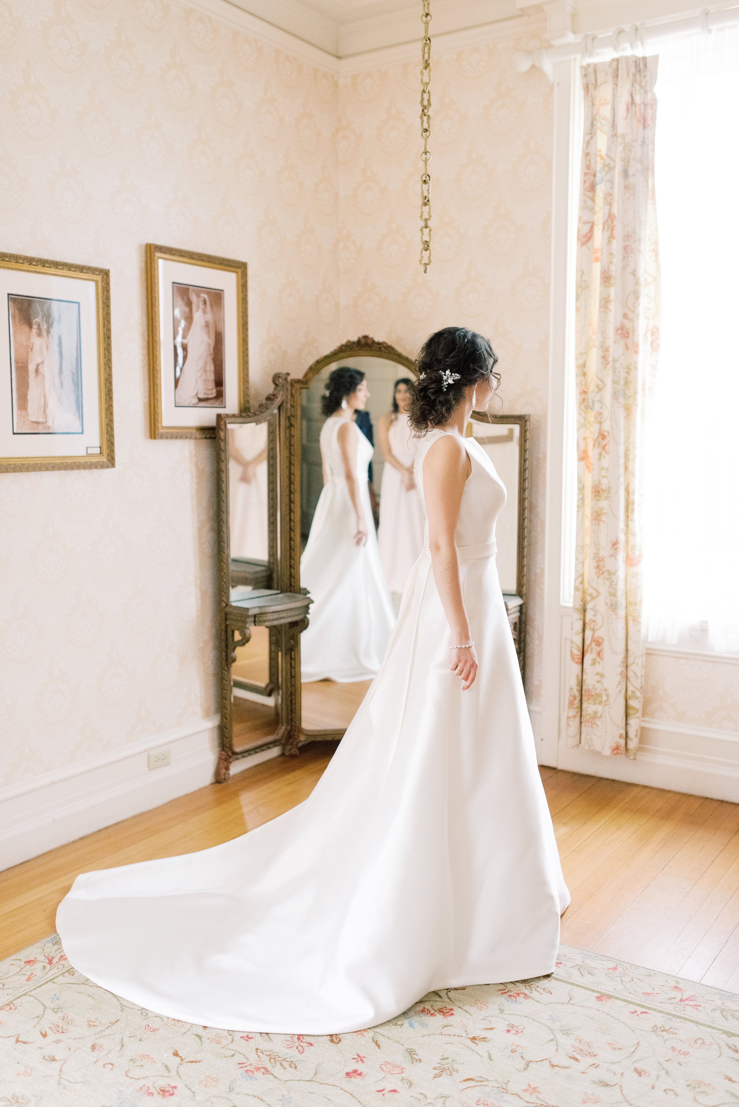 Carinwood Estate has the most elegant bridal suite for their brides to get ready in, we loved how Angjela looked here with her modern a-line wedding dress for her romantic and classic wedding day for their french inspired green and white Cairnwood Estate wedding