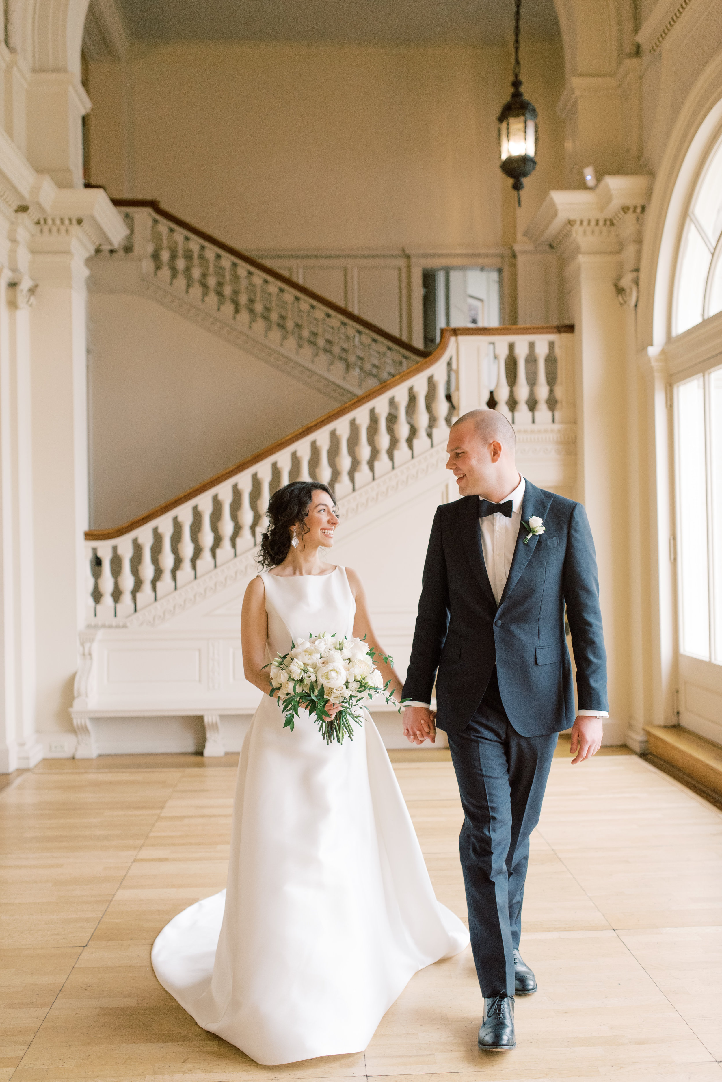 We can't get enough of how classy these two look in the great hall for their romantic and classic wedding day for their french inspired green and white Cairnwood Estate wedding