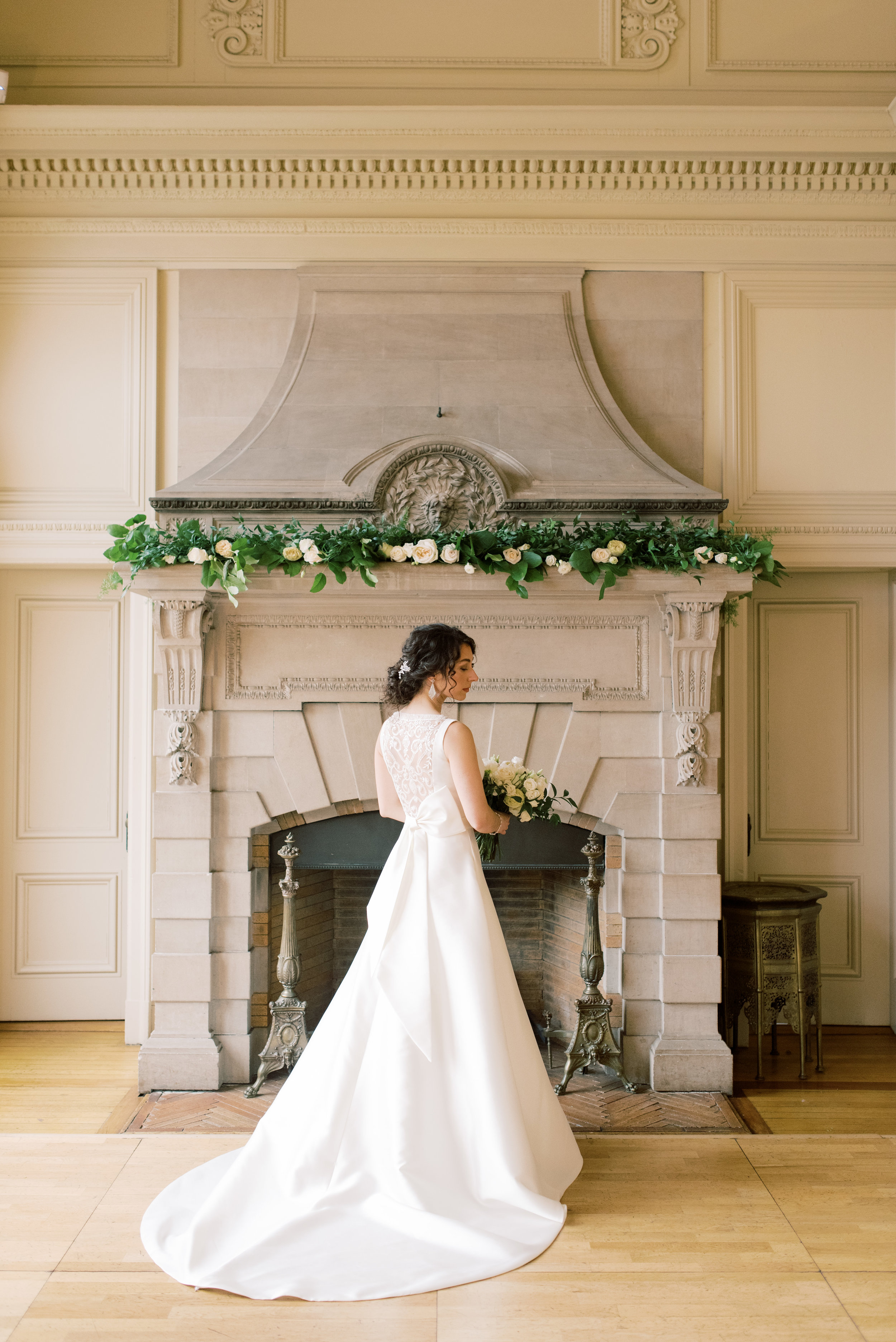 We simply adored the modern asymmetrical bow on the back of this structured a-line wedding gown from this romantic and classic wedding day for their french inspired green and white Cairnwood Estate wedding