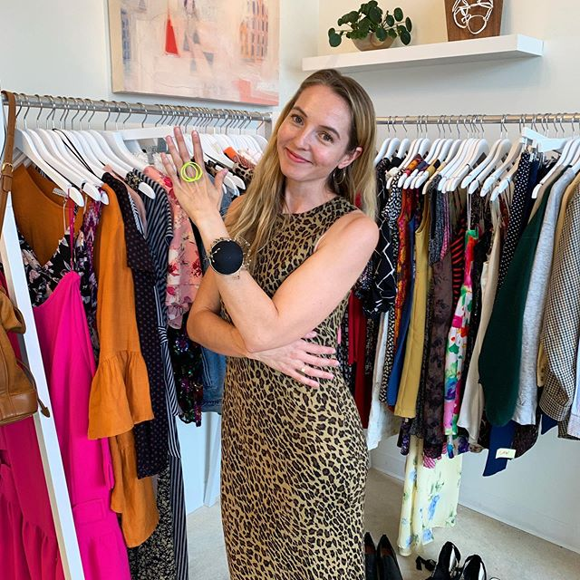 The lovely Erin of @stitchedup is modeling the stunning chartreuse statement ring by @laurawoodstudios & Salt original hoops in front of all the amazing vintage clothing she brought with her today (custom tailor available on spot). We will be open until 7p!