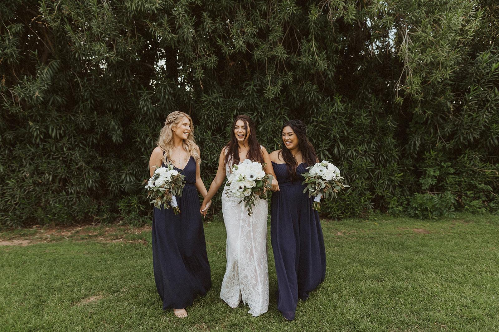 bridesmaids_and_bride_laughing.jpeg