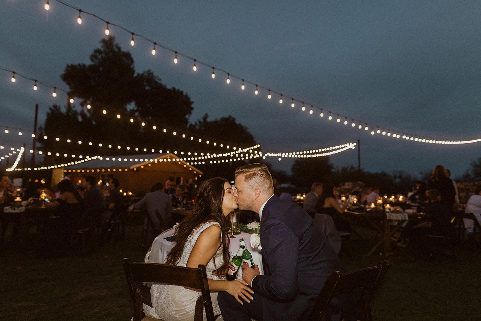 kiss_under_lights_at_the_farm.jpeg
