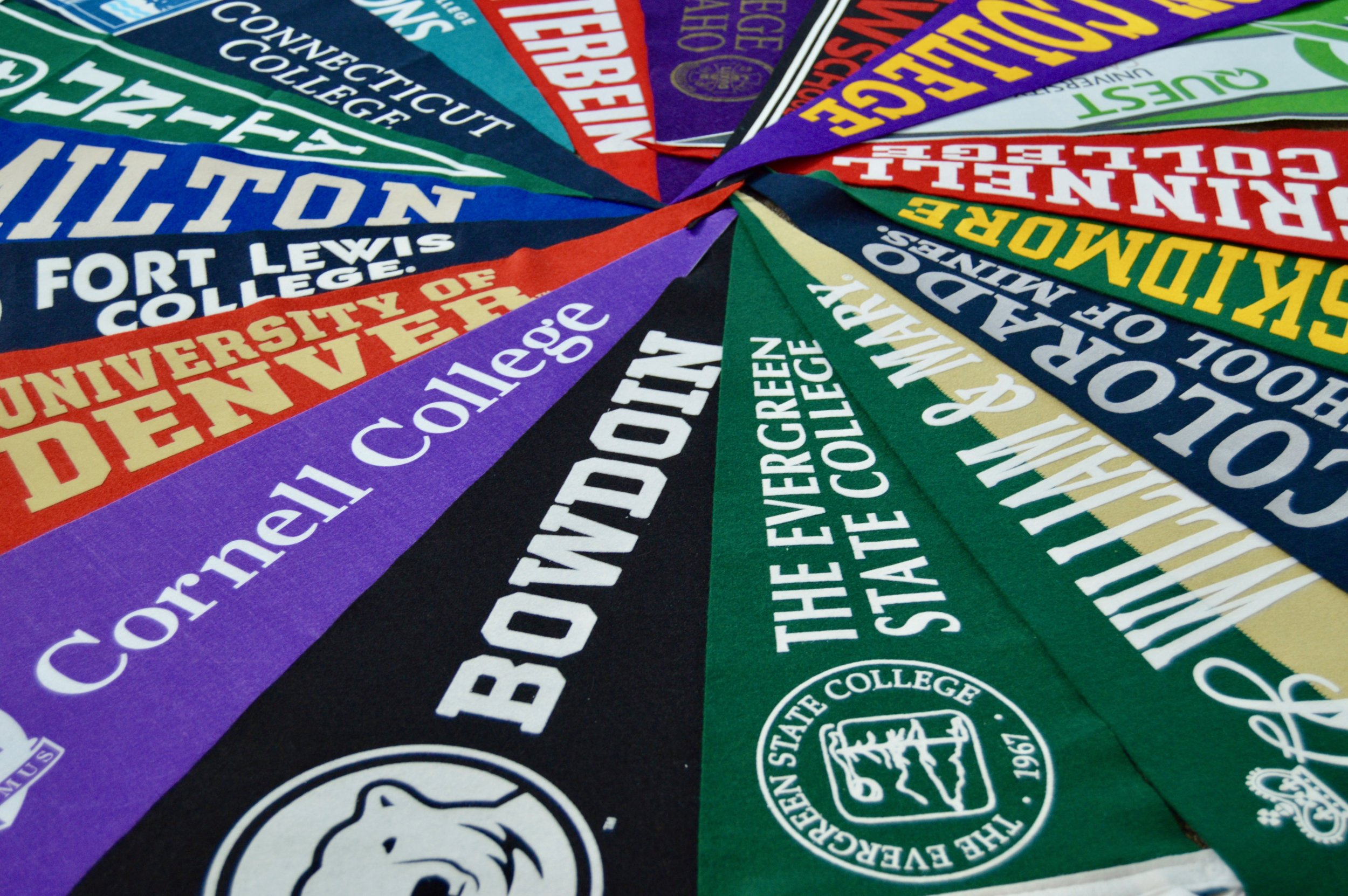 Flags from each of the colleges and universities that Peak students have been accepted to (Smith/Peak).