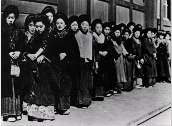 Picture brides arrive in America and wait to meet their new husbands.
