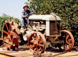 Eiichi Sakauye transports a tractor to the exhibit at JAMsj.
