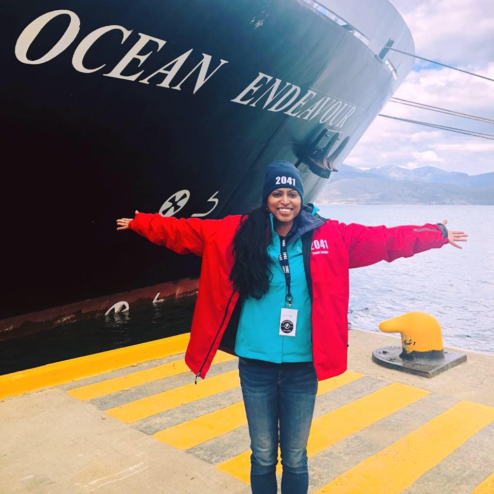 Divya in front of Ocean Endeavour in February getting ready to depart on her second expedition to Antarctica!