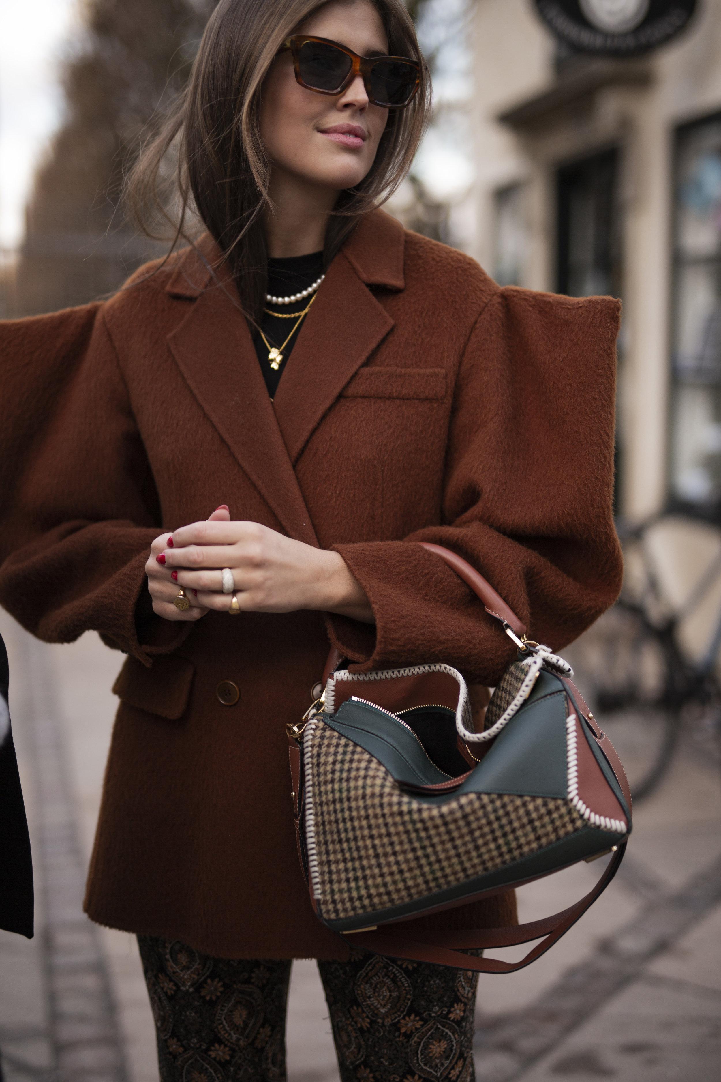 Streetstyle during Copenhagen Fashion Week. Here is beautiful Darja Barannik in a design jacket from Annikiki