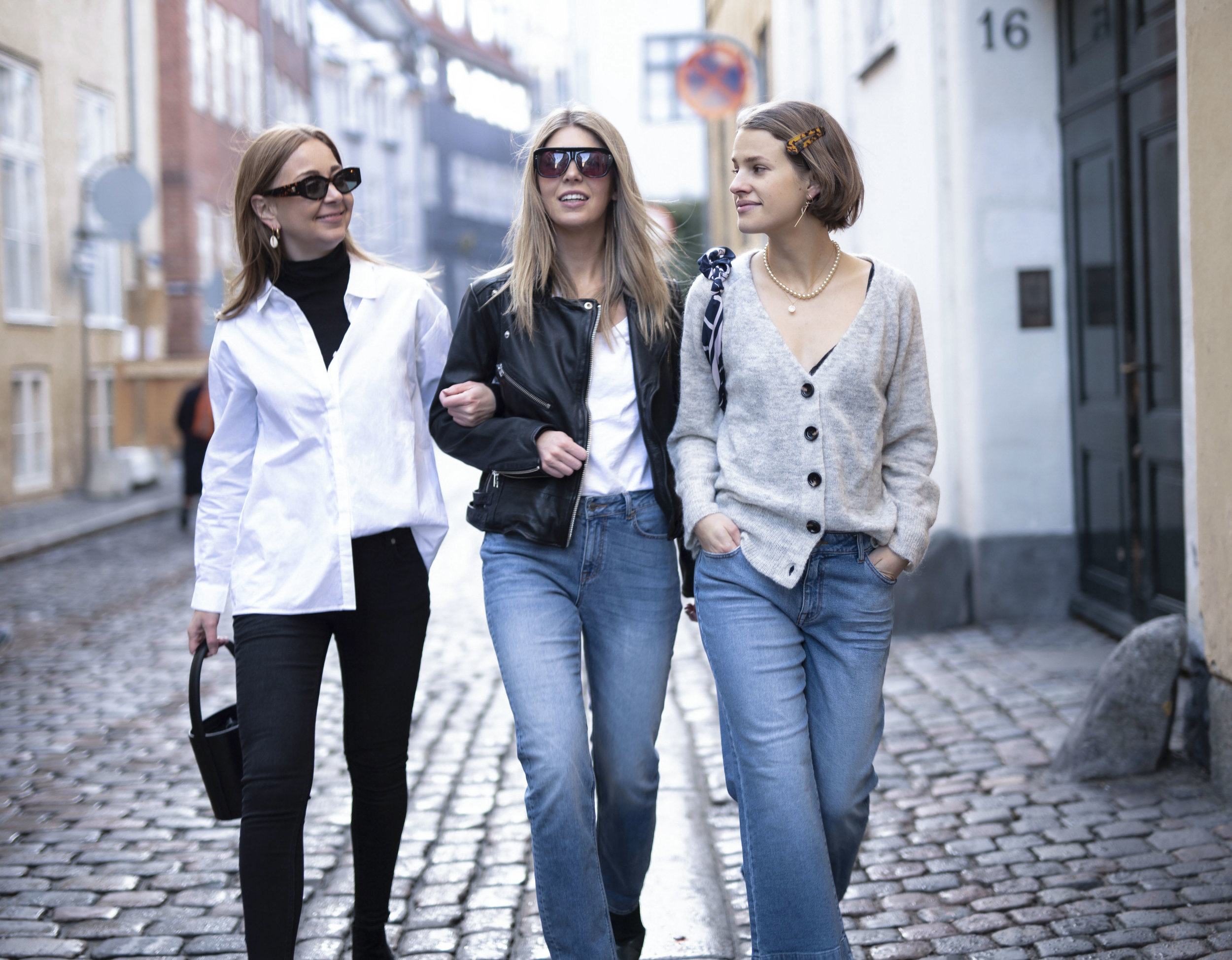 Katrine Krog, Cathrine Marie and Julie Blichfeld power walking on the streets of Copenhagen wearing Denim Hunter clothes from top to toe