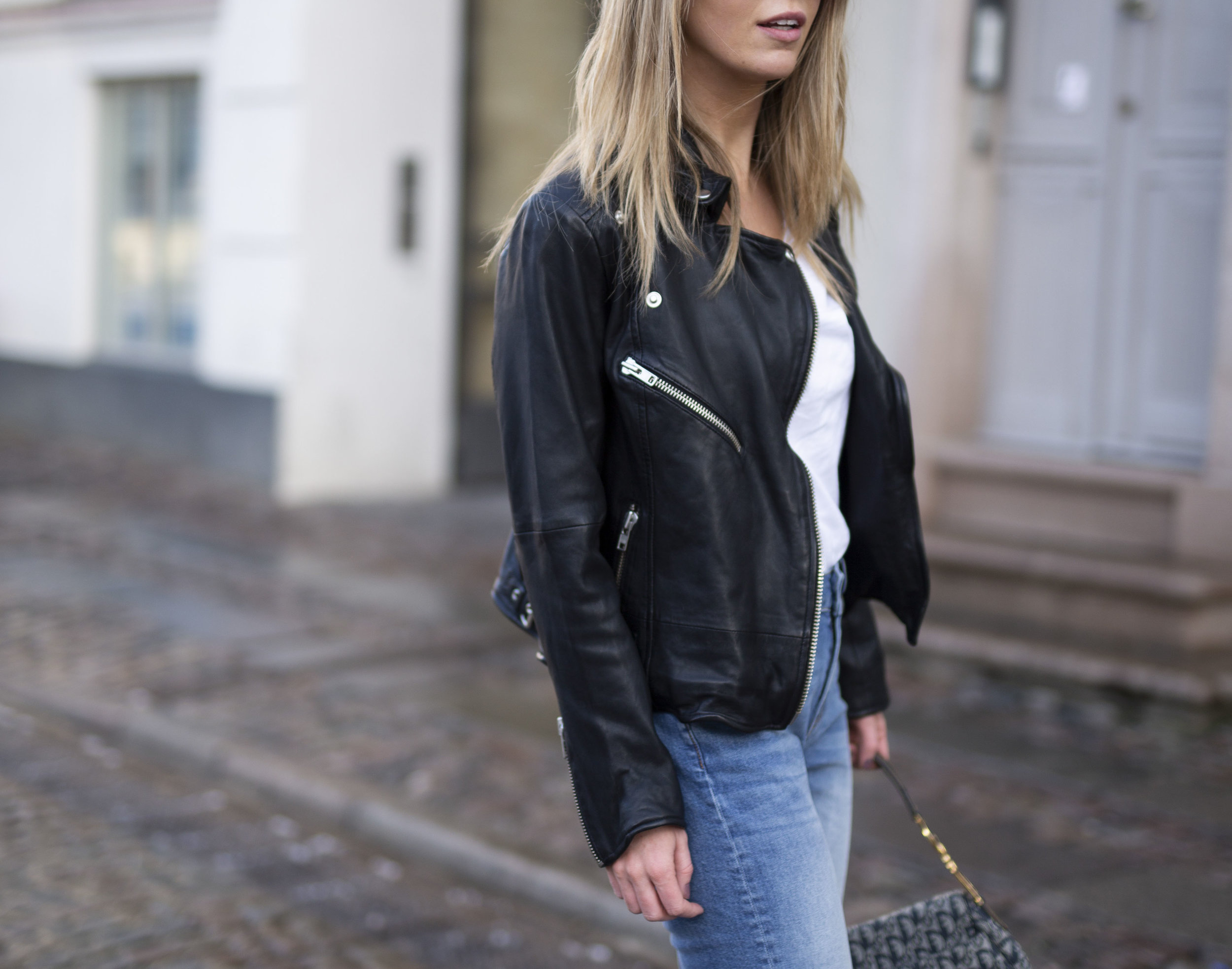 Cathrine Marie walking on the streets of Copenhagen wearing Denim Hunter clothes
