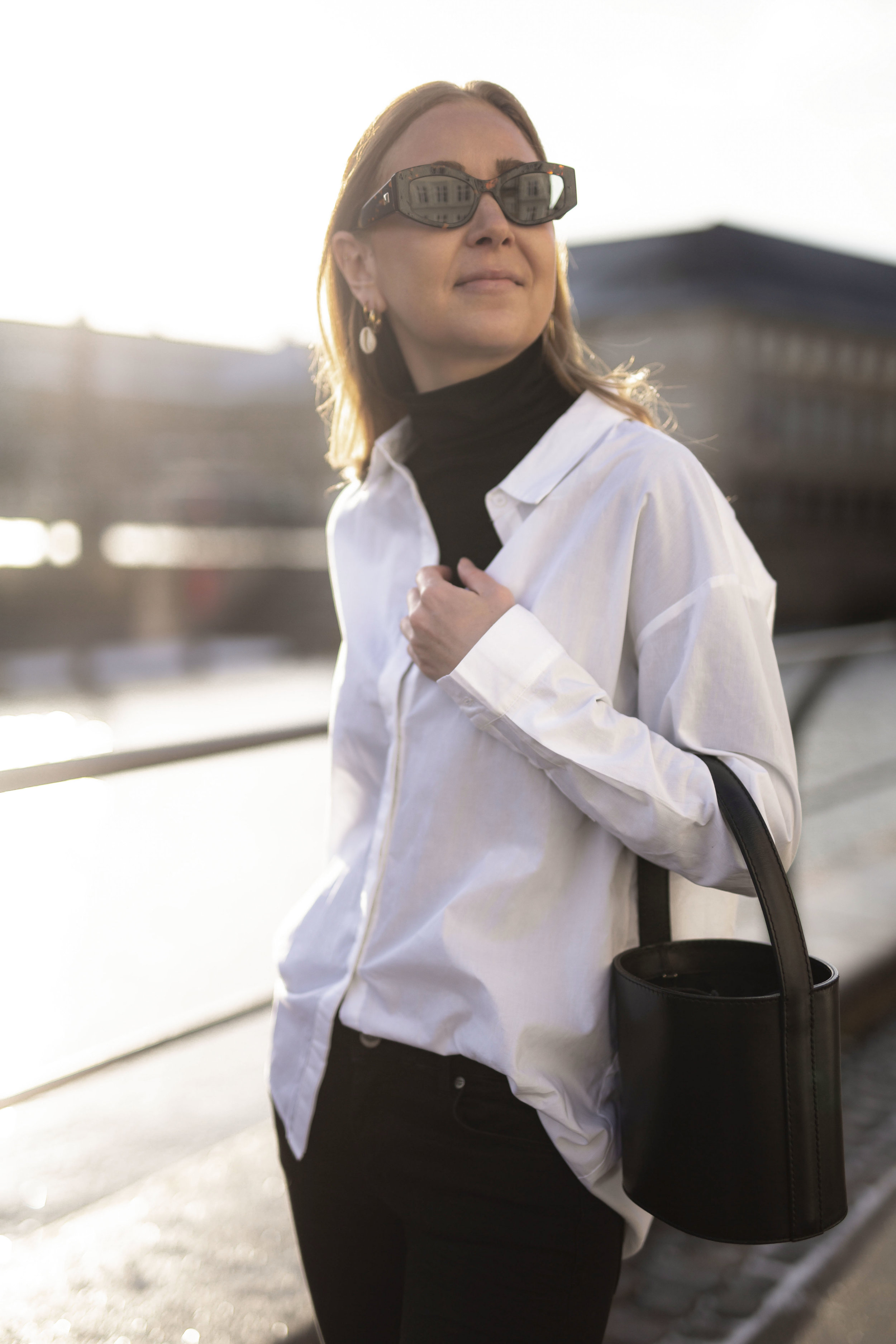 Katrine Krog on the streets of Copenhagen wearing Denim Hunter shirt and black denim pants