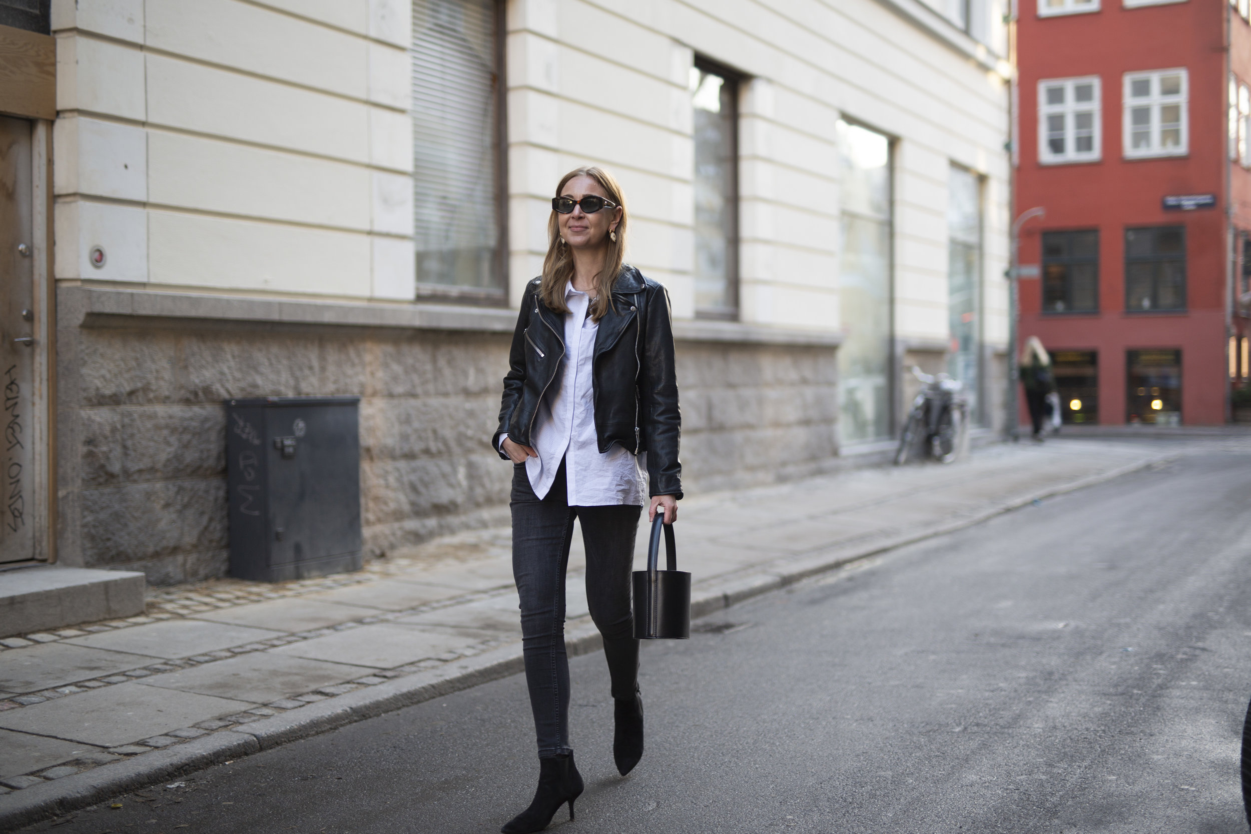Katrine Krog on the streets of Copenhagen wearing black and white Denim Hunter from top to toe
