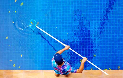 Swimming-Pool-Cleaning[1].jpg