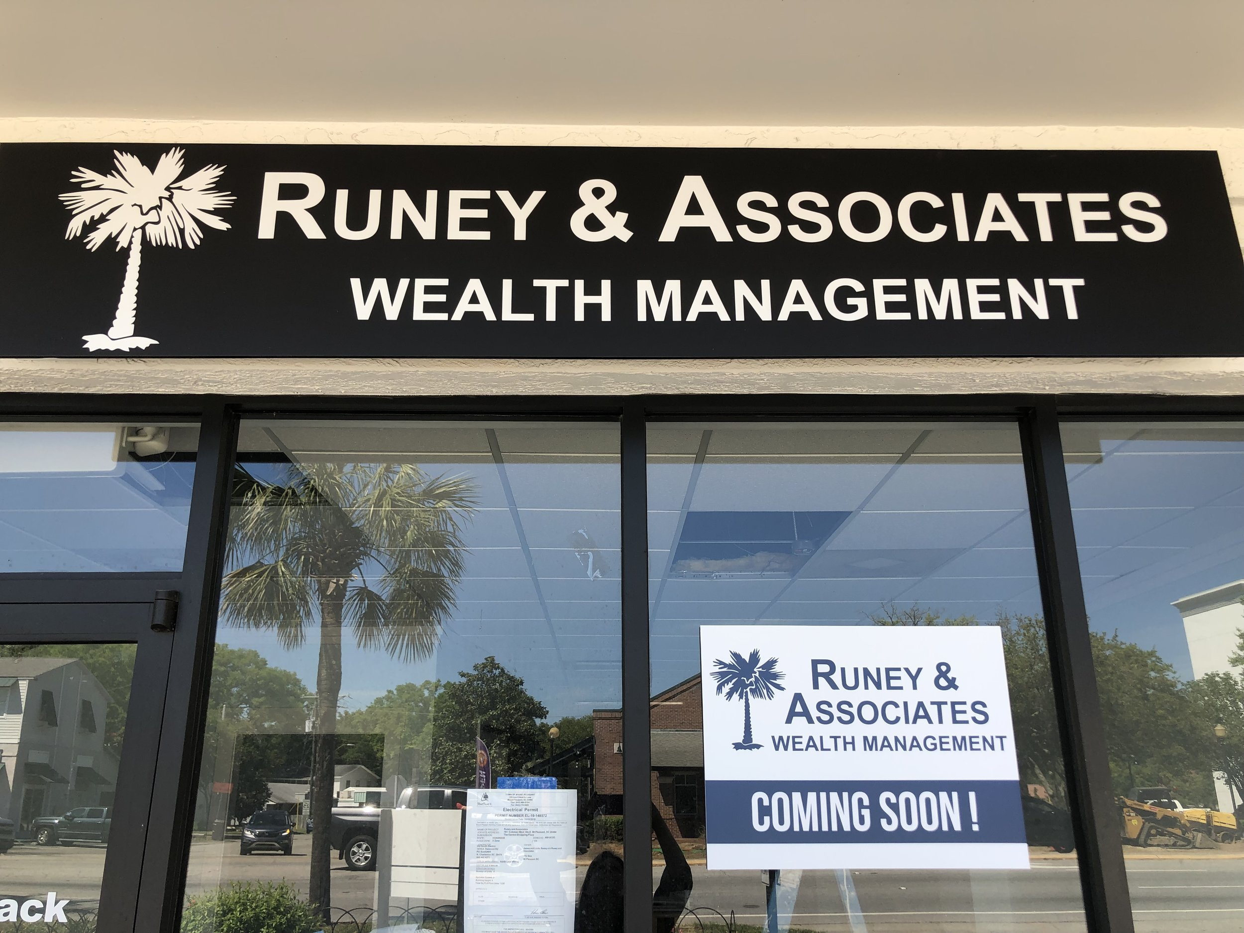 Front Entrance sign is up as well as a Coming Soon sign in the window!