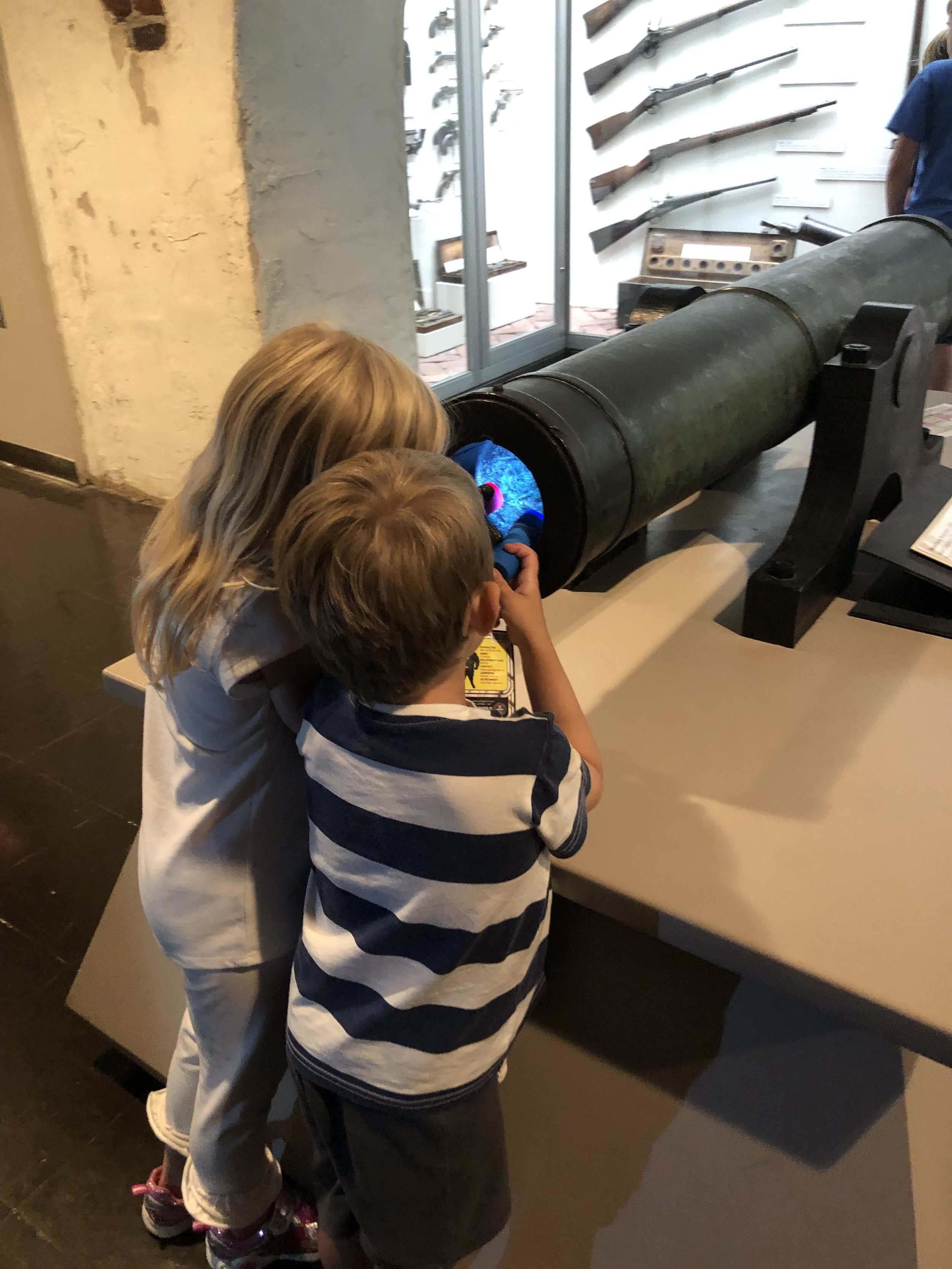 Checking out the cannon with our flashlights!