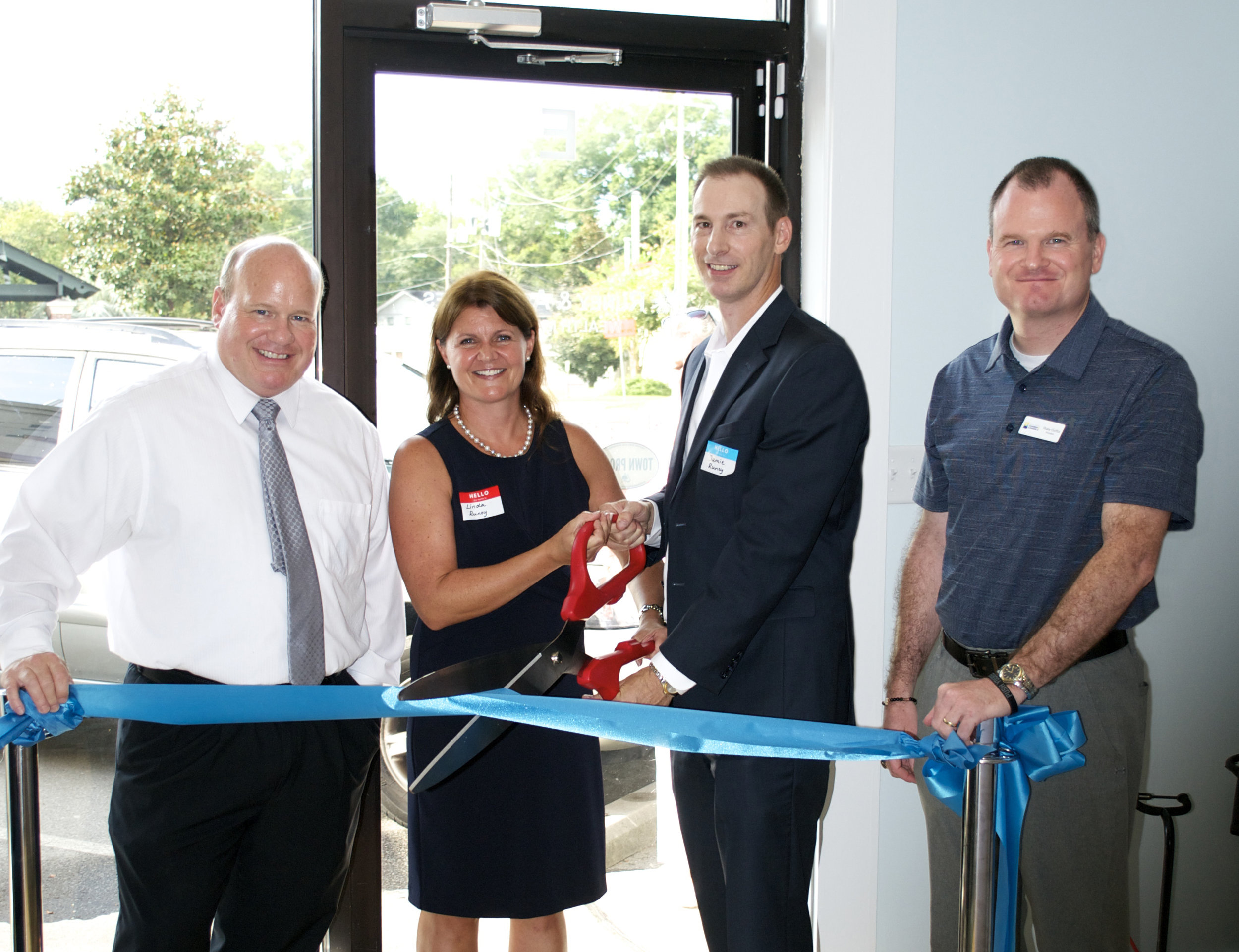 Runey & Associates Wealth Management ribbon cutting ceremony with representatives John Holladay (left) from the Town of Mount Pleasant and Shane Griffin (right) from the Mount Pleasant Chamber of Commerce