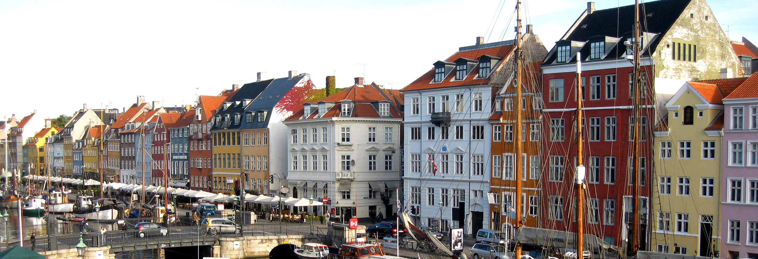 Photo of the old houses in Nyhavn where Hans Christian Andersen once lived. The colour of have a heart graphics mirror those of the old houses.