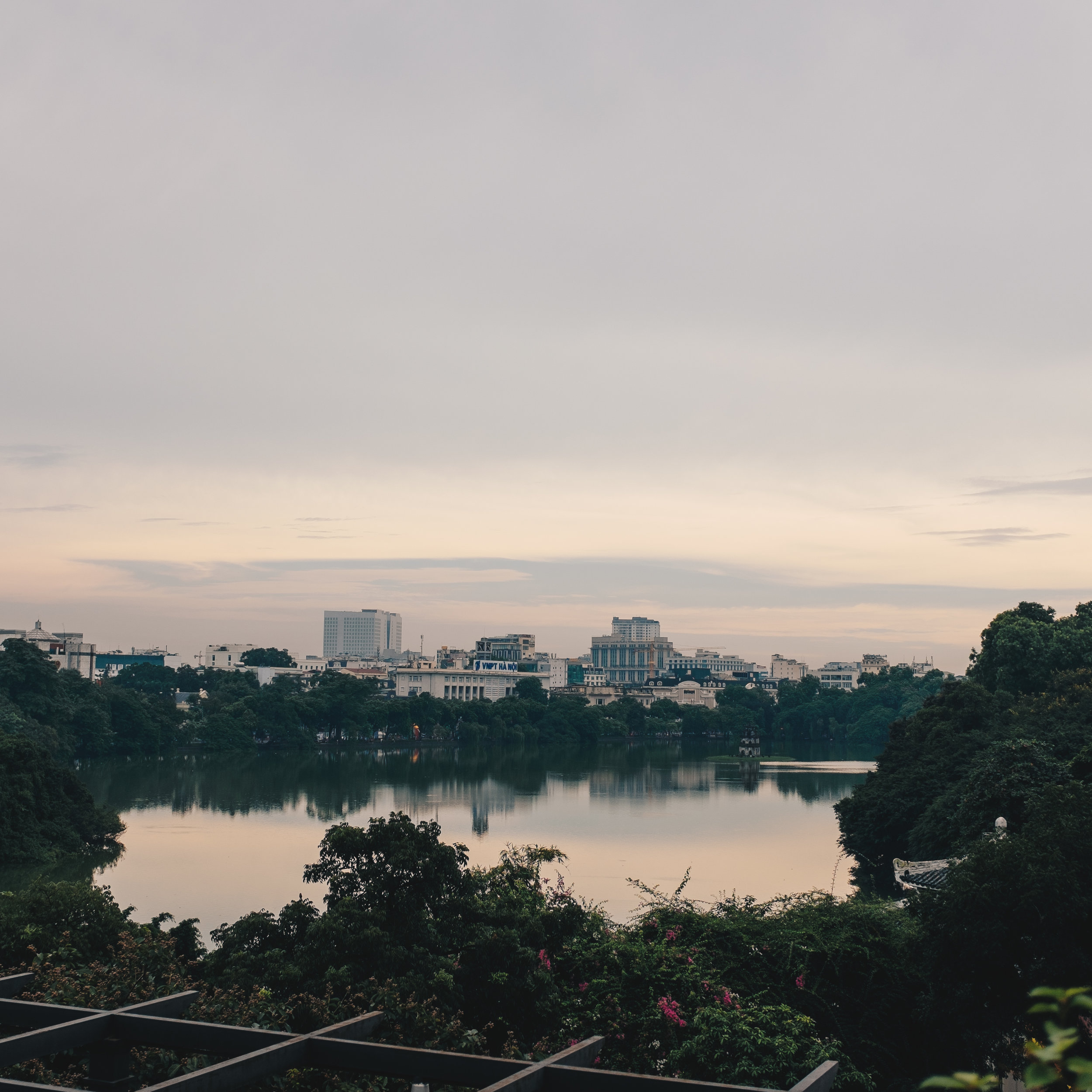 Sipping Vietnamese drip coffee whilst overlooking the view of Hoan Kiem Lake