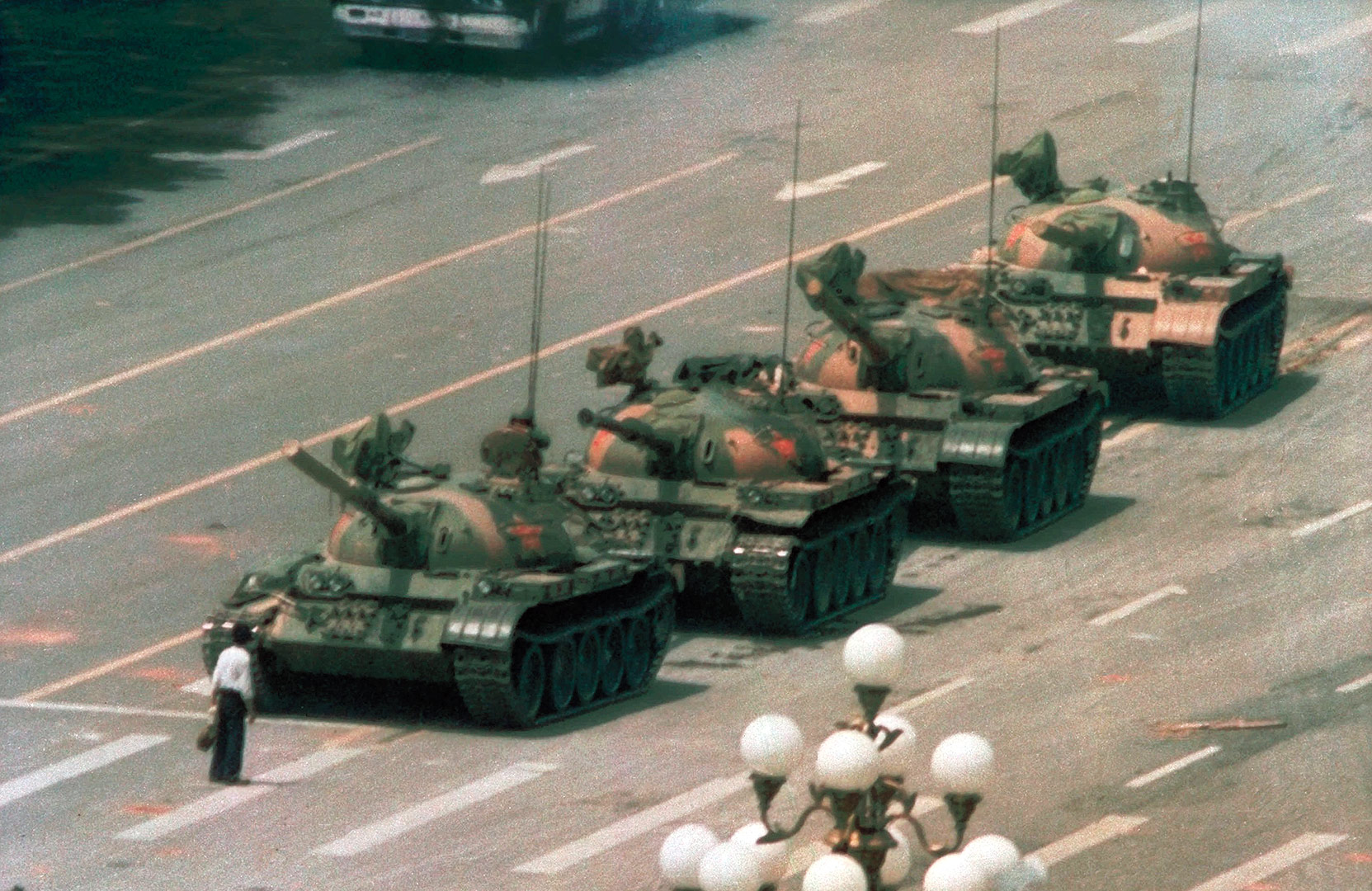 The famed photograph taken in 1989 by Jeff Widener at the height of the Tiananmen Square Protests, photo from TIME