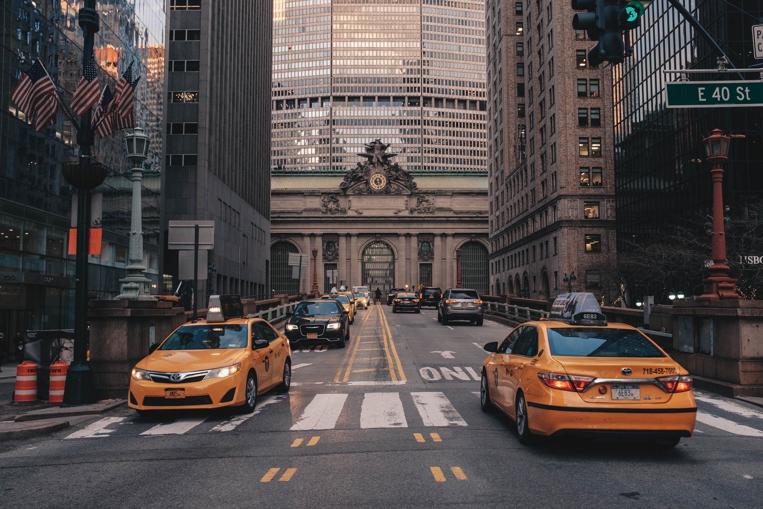 With Grand Central Terminal in the background, two of New York City's iconic modes of transport are juxtaposed as a shining model of mobility