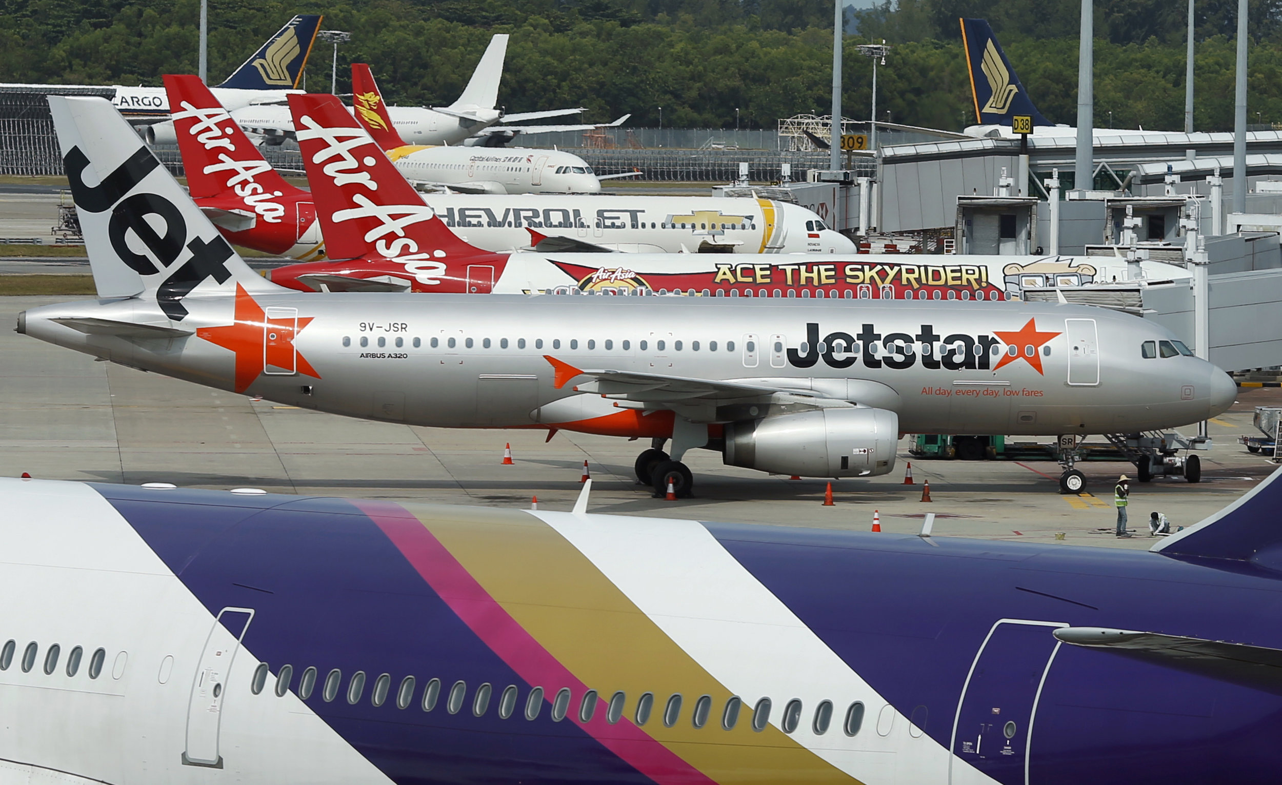 Jetstar and AirAsia are both carriers that have benefitted greatly from passengers demand between Singapore and Kuala Lumpur,  photo from Business Insider