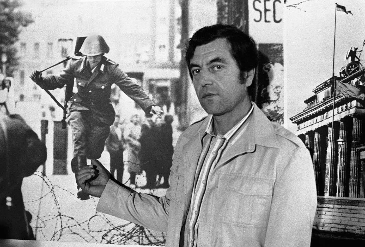 Conrad Schumann poses in front of the famous photograph 'Leap Into Freedom' 12 years after his stunning defection,  photo from RareHistoricalPhotos