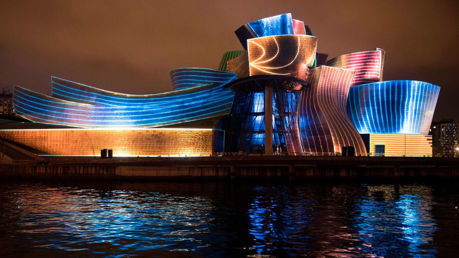 The Guggenheim Bilbao at night, photo from  Ander Gillenea via Chicago Tribune