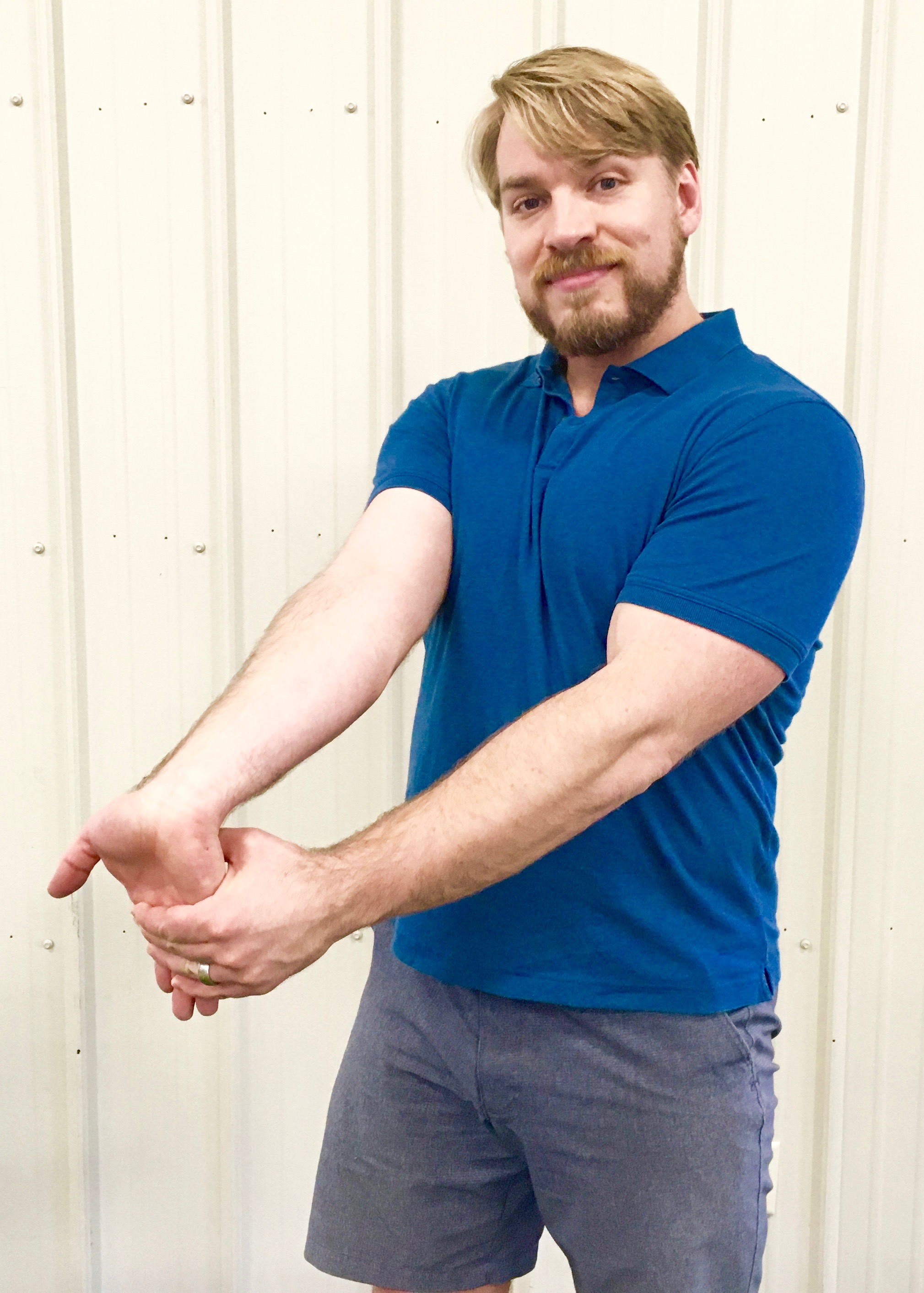 Test 2: Straighten your injured arm with palm facing up. Use the opposite hand to bend your hand down at the wrist but resist it with the injured arm.