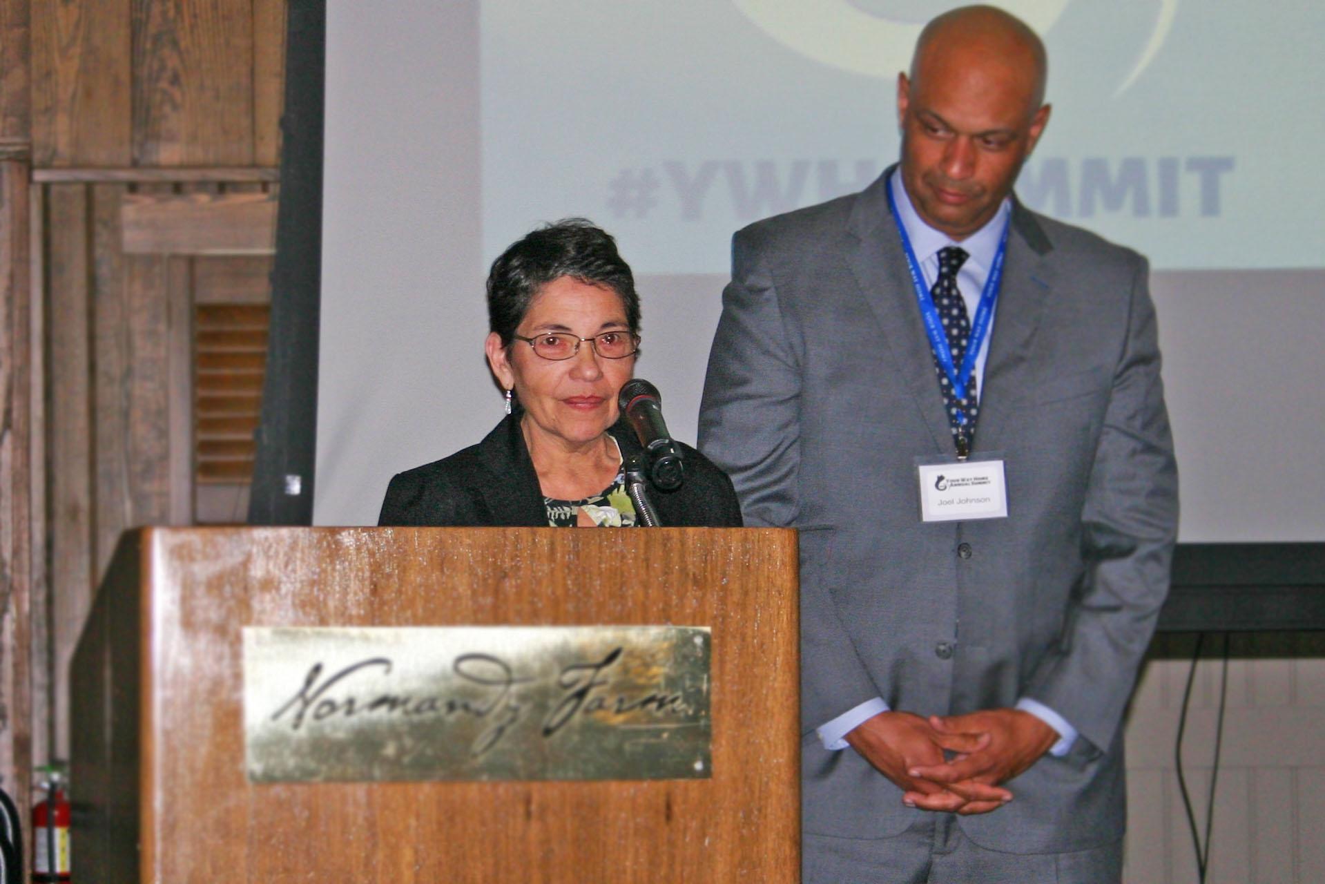 Ann Garcia at podium.jpg