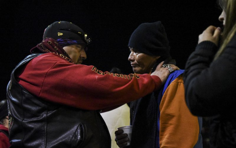 "Doug ""Bishop"" Anaya comforts Ben, a homeless man, on Central Avenue near Louisiana Boulevard after Ben decides to enter a rehabilitation program on Feb. 2, 2019. / Photo by Celia Raney / NM Newsport"
