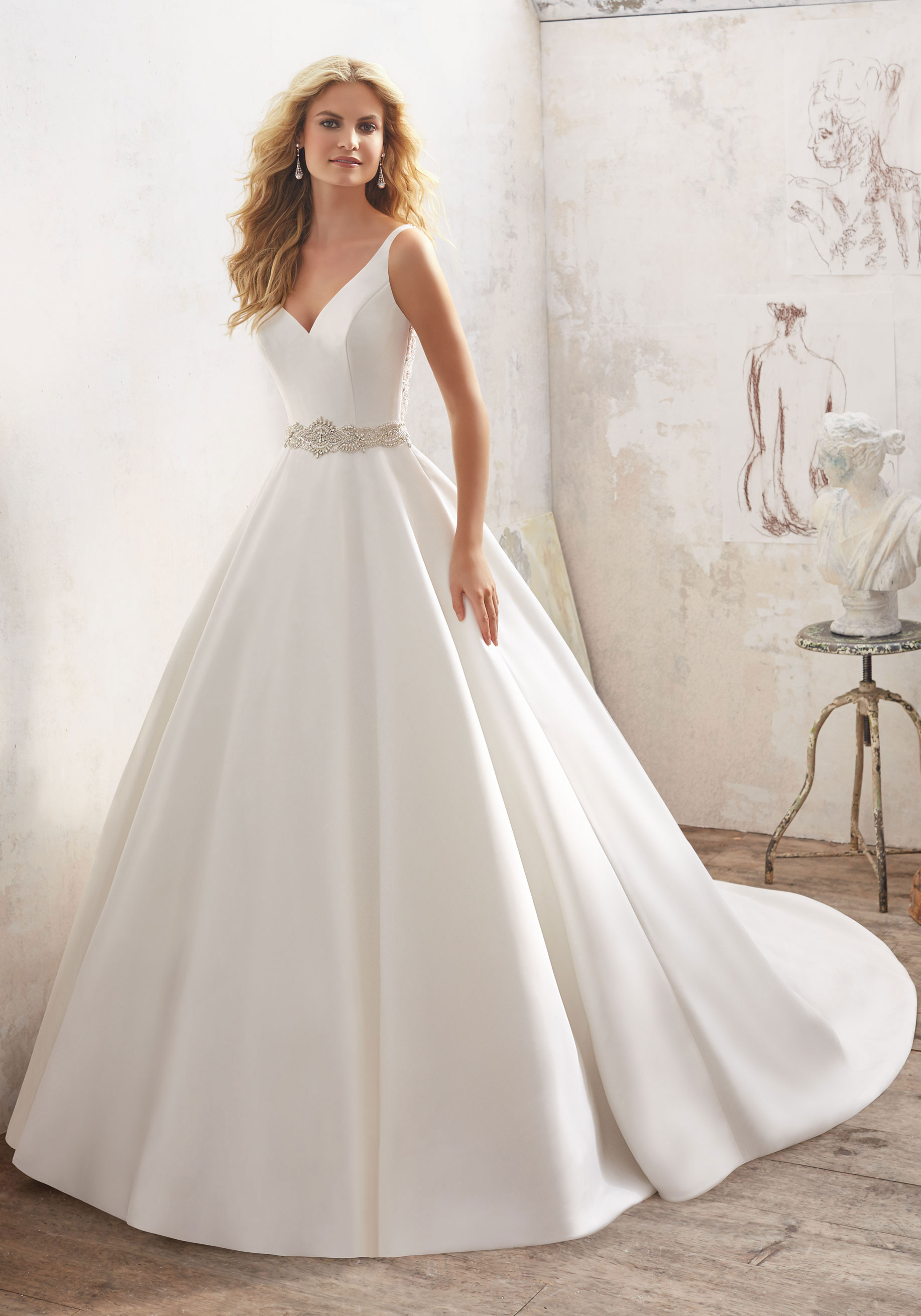 Morilee Blu - In the Morilee by Madeline Gardner's Blu Collection, the designs find the perfect harmony between classic and contemporary. So while you've always pictured yourself in that beautiful white dress, there's no reason you can't blend the newest trends or styles while you're at it.