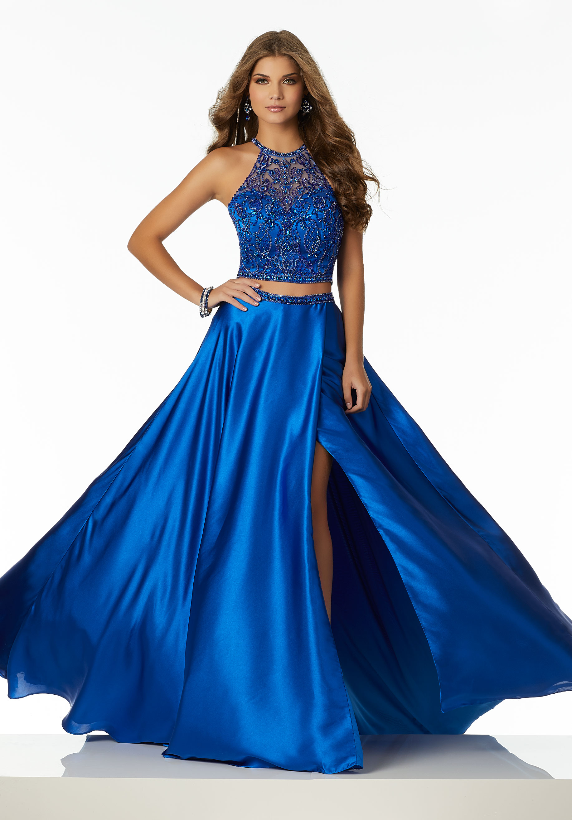 Morilee - The Morilee Prom Dress Collection is fabulously fun and forward for the contemporary, confident woman. Swarovski crystals, sparkling fabrics and embroideries, lace, tulle, chiffon and jersey with modern detailing encompass the spectrum of this uniquely designed Collection.