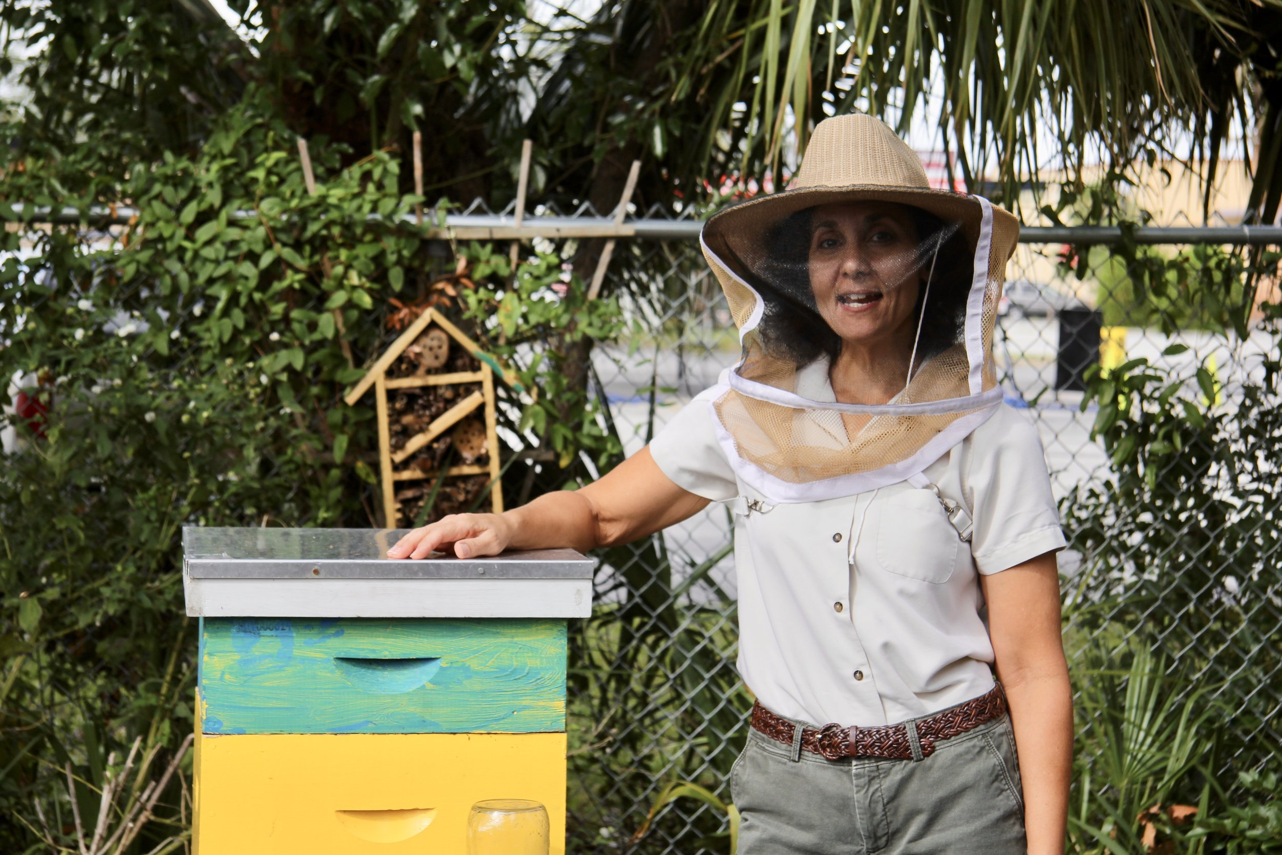 Marilyn Young, Jacksonville beekeeper, stands next to one of her hives.